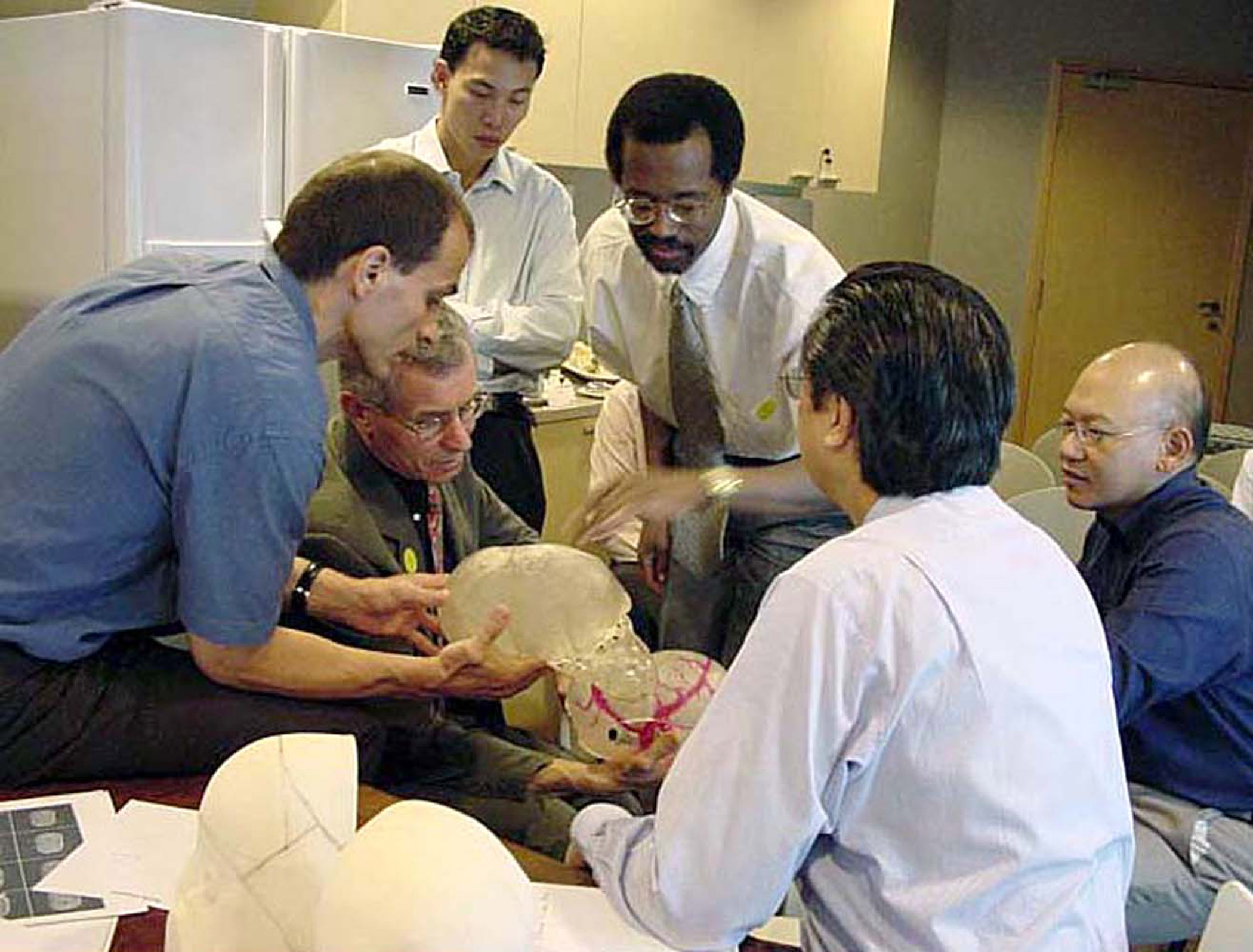 Dr Dennis Rohner, Dr Beat Hammer, Dr Ivan Ng, Dr Ben                                   Carson, Prof. Walter Tan, and Dr Keith Goh rehearse an operation to                                   separate conjoined twins Ladan and Laleh Bijani from Iran at Raffles                                   Hospital on July 5, 2003  in Singapore.