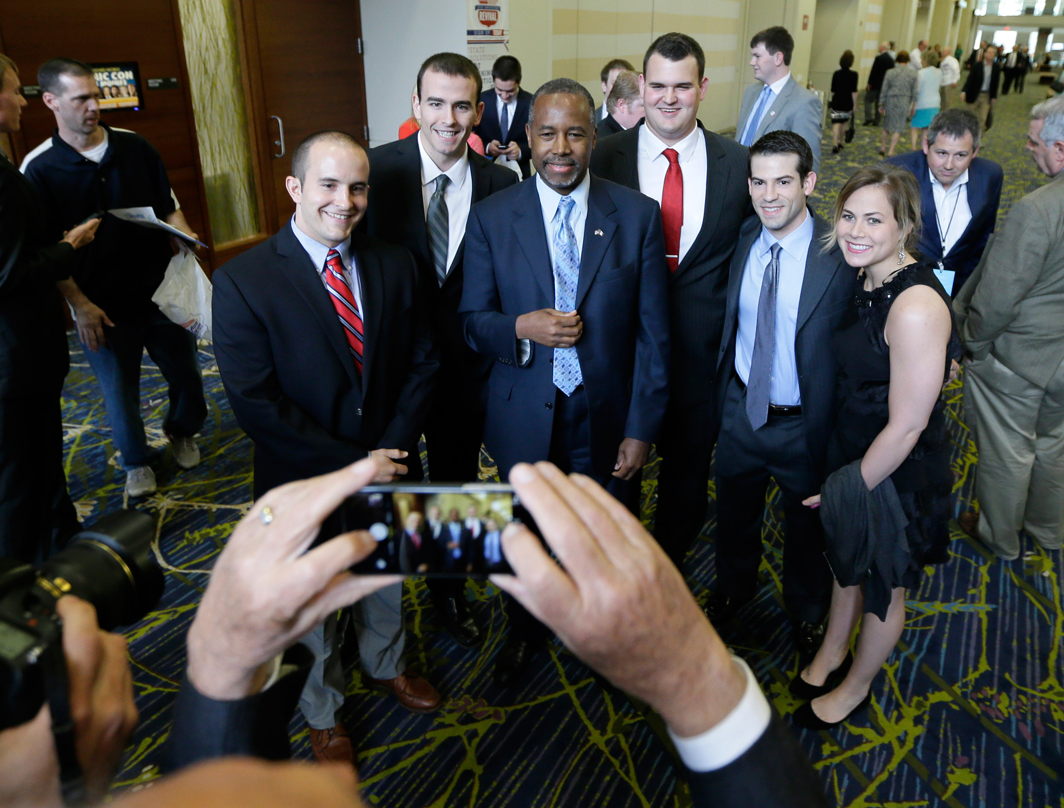 Ben Carson poses for a photo during the Iowa Republican Party's Lincoln Dinner on May 16, 2015, in Des Moines, Iowa.