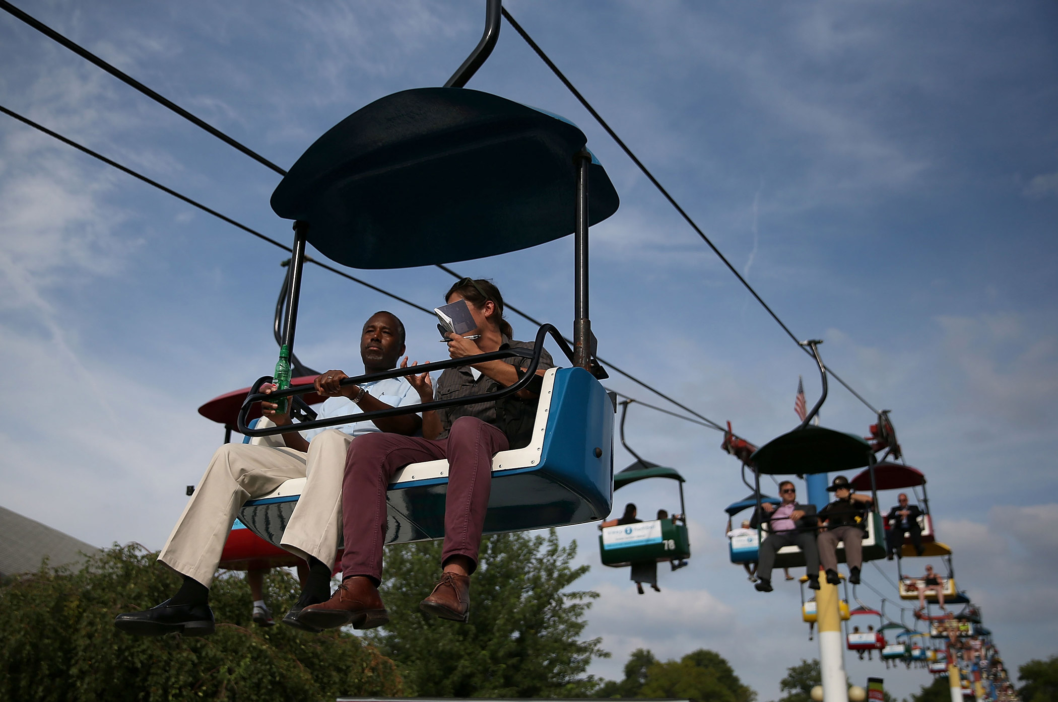 Ben Carson rides the Sky Glider with a reporter while touring the Iowa State Fair on Aug. 16, 2015 in Des Moines, Iowa.
