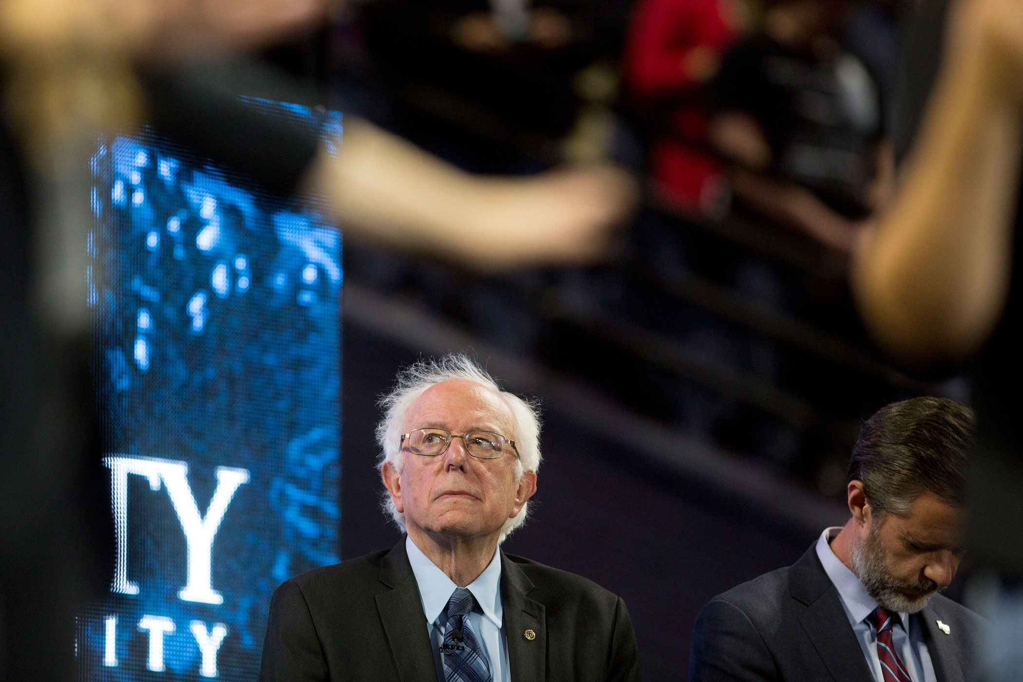 Senator Bernie Sanders, an independent from Vermont and 2016 Democratic presidential candidate, left, and Jerry Falwell Jr., president of Liberty University, listen to a prayer during a Liberty University Convocation in Lynchburg, Virginia, on Sept. 14, 2015.