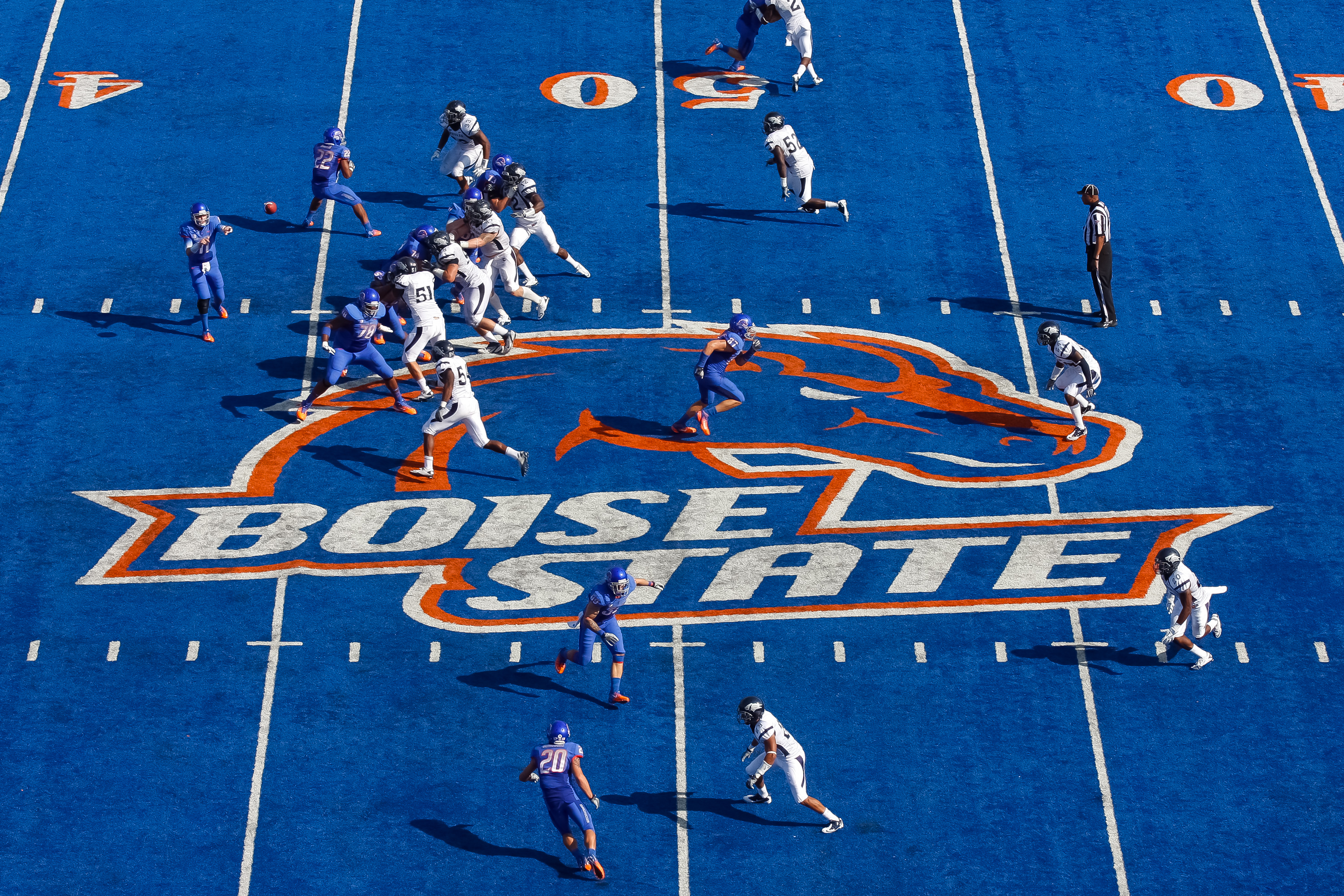 Kellen Moore #11 of the Boise State Broncos (L) passes against the Nevada Wolf Pack at Bronco Stadium in Boise, Idaho on Oct. 1, 2011.