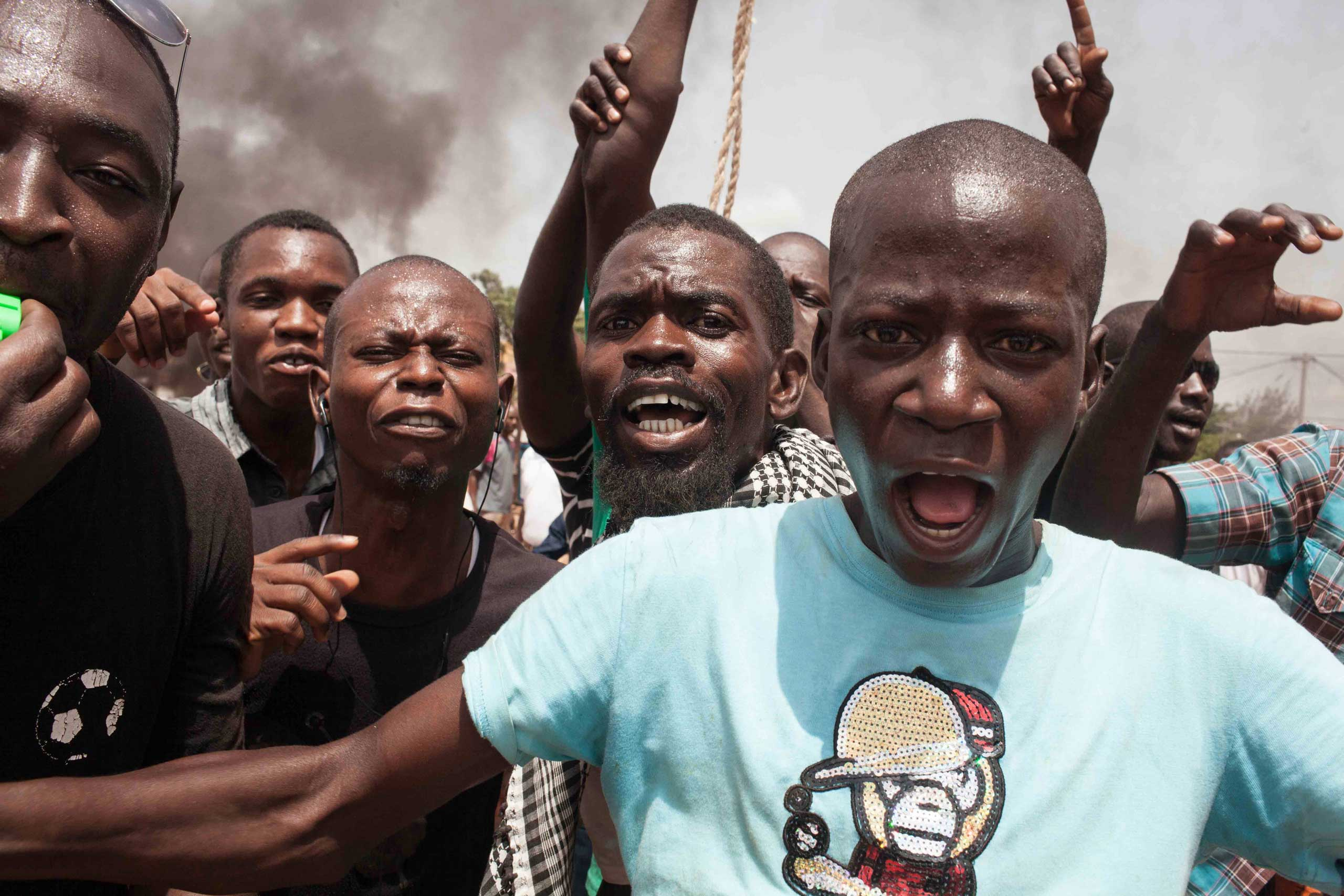 Burkina Faso protestors shout out as they take to the streets in the city of Ouagadougou, Burkina Faso, on Sept. 17, 2015.