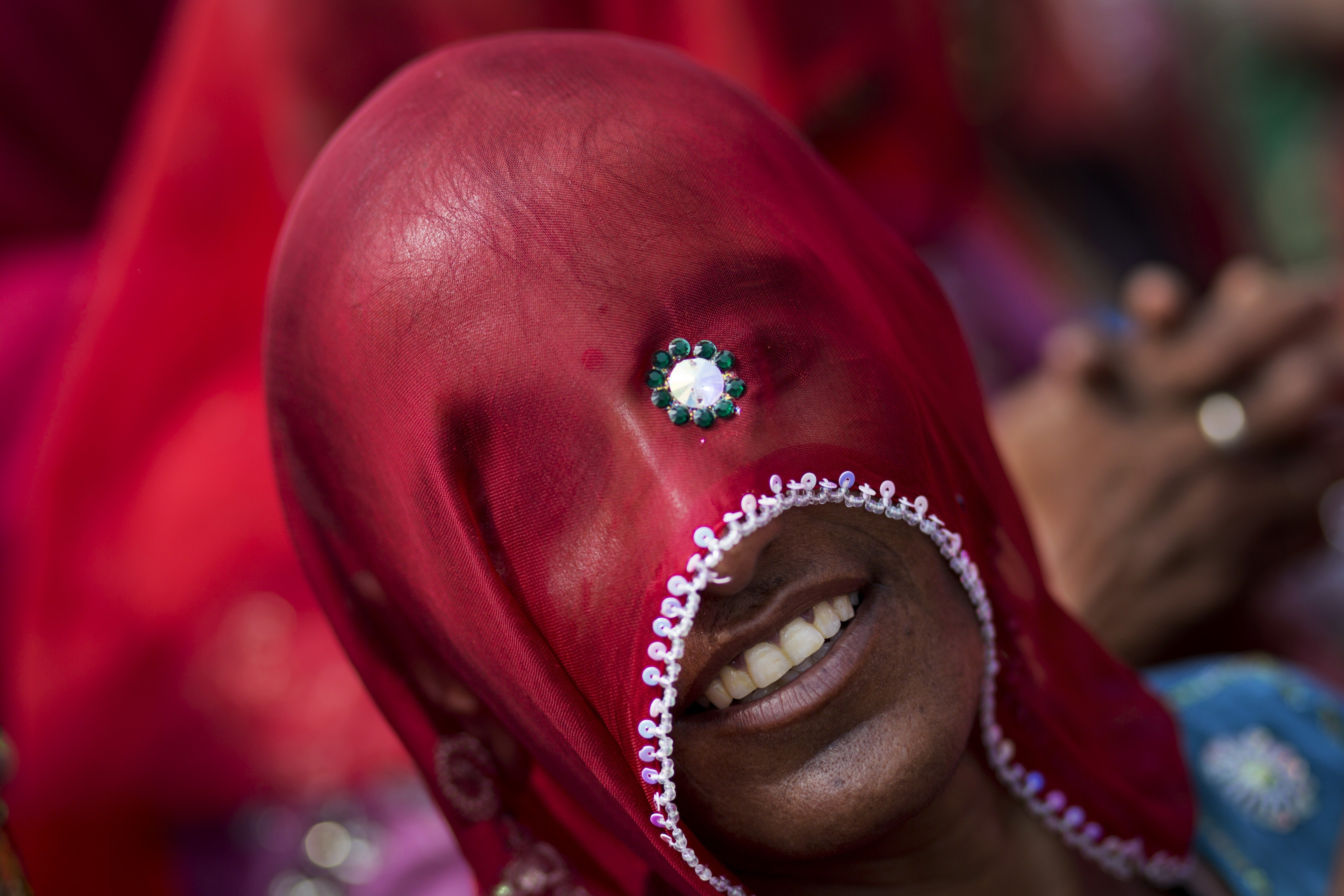 A Hindu woman from Rajasthan participates in a religious procession during Kumbh Mela, or Pitcher Festival, at Trimbakeshwar, India, on Aug. 27, 2015.