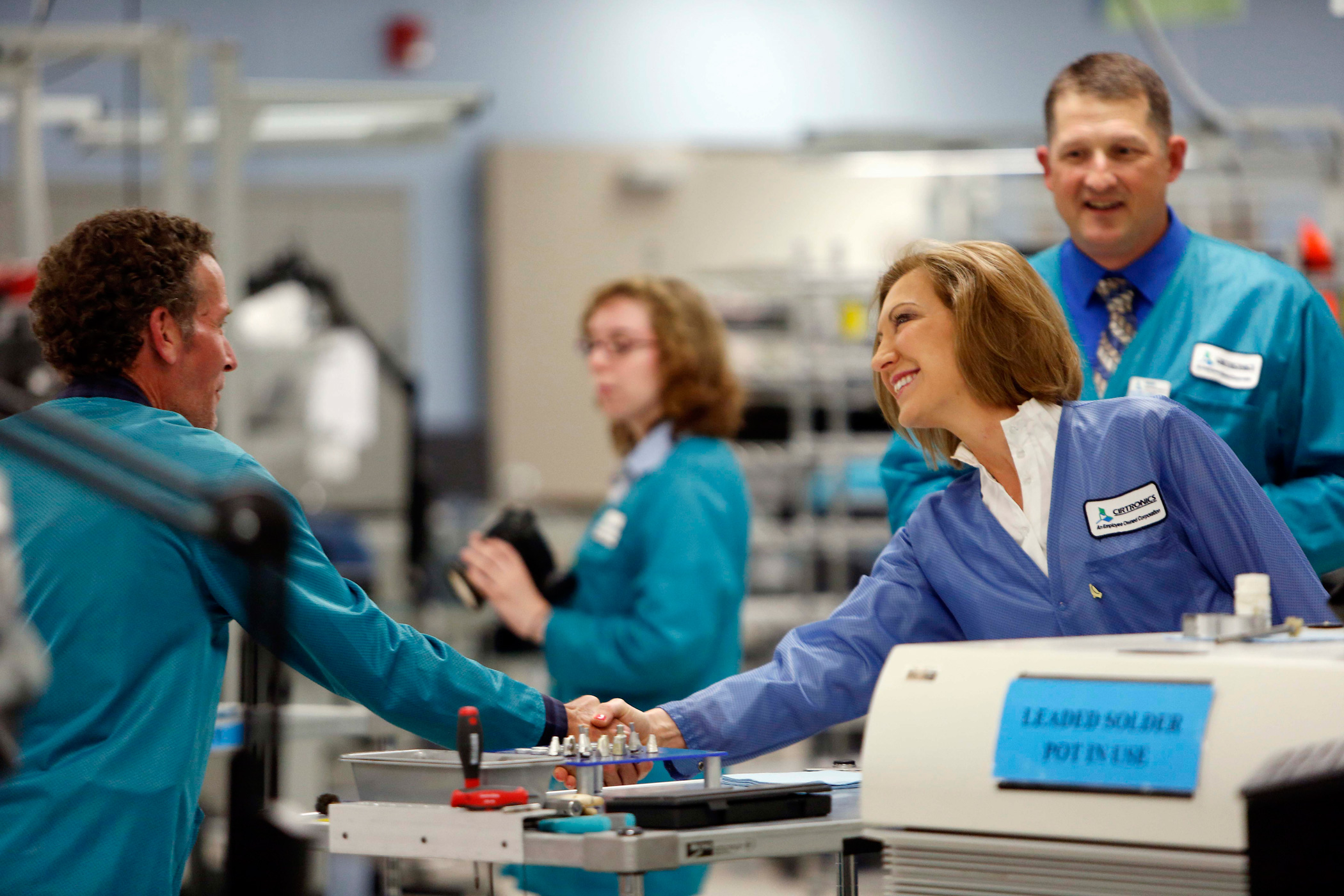 Carly Fiorina, shakes hands with employees during a tour of Cirtronics on June 10, 2015, in Milford, N.H.