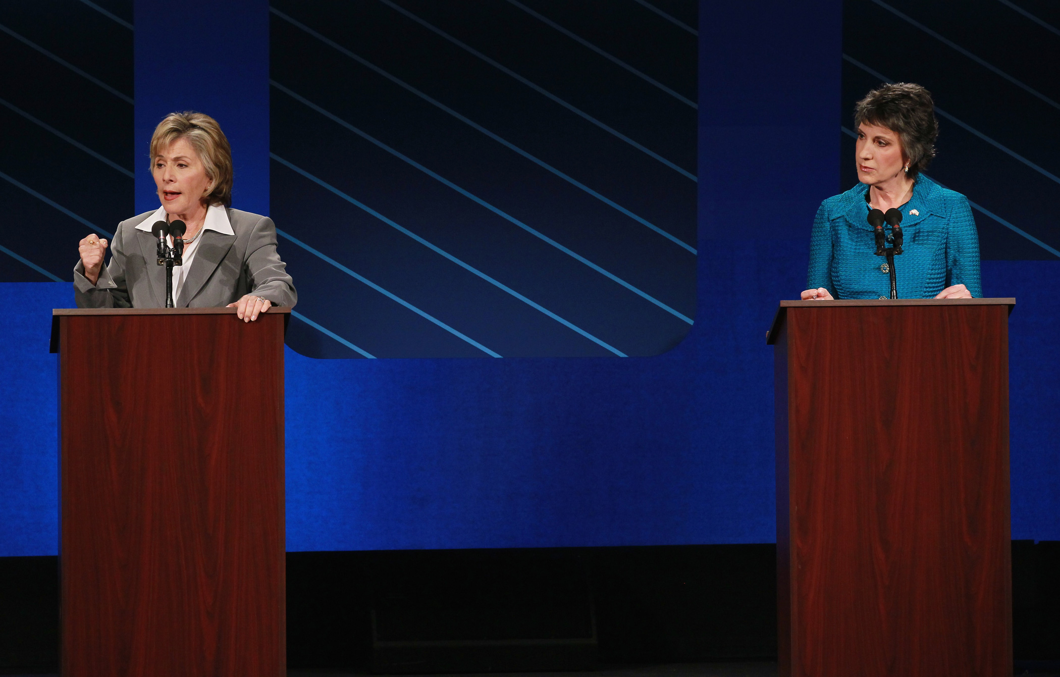 Barbara Boxer speaks as Republican challenger Carly Fiorina looks on during a debate on the campus of Saint Mary's College on Sept. 1, 2010 in Moraga, Calif.