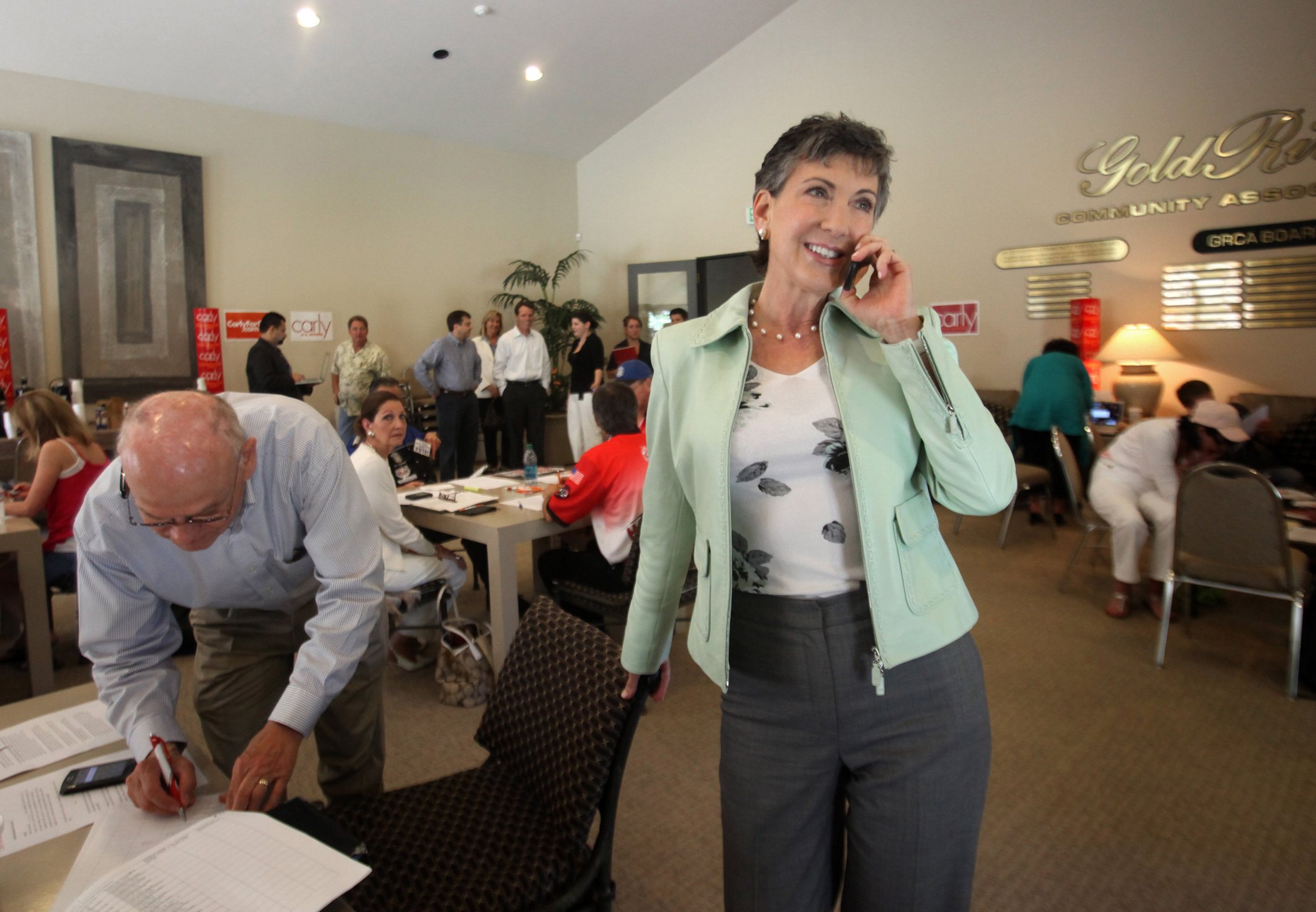 Carly Fiorina talks to a potential voter during her visit to a phone bank during her Senate campaign on June 5, 2010 in Gold River, Calif.
