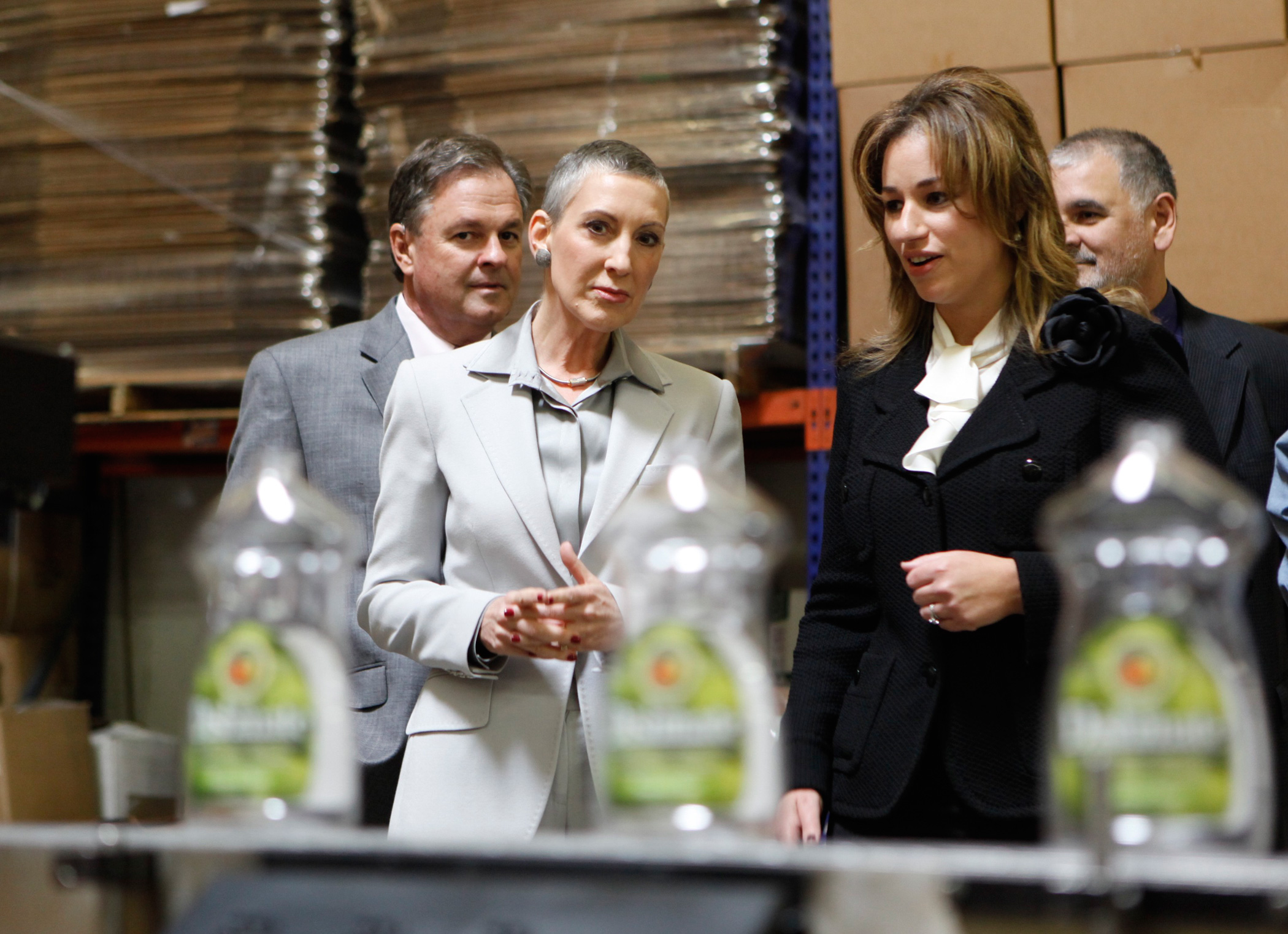 Carly Fiorina and her husband Frank take a tour with Earthfriendly Products vice president, Kelly Vlahakis-Hanks, right, on Nov. 4, 2009, in Garden Grove, Calif.