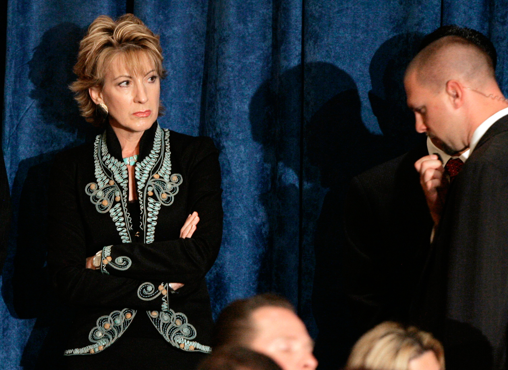 Carly Fiorina, listens as  Sen. John McCain speaks during a town hall-style meeting on May 20, 2008 in Miami.