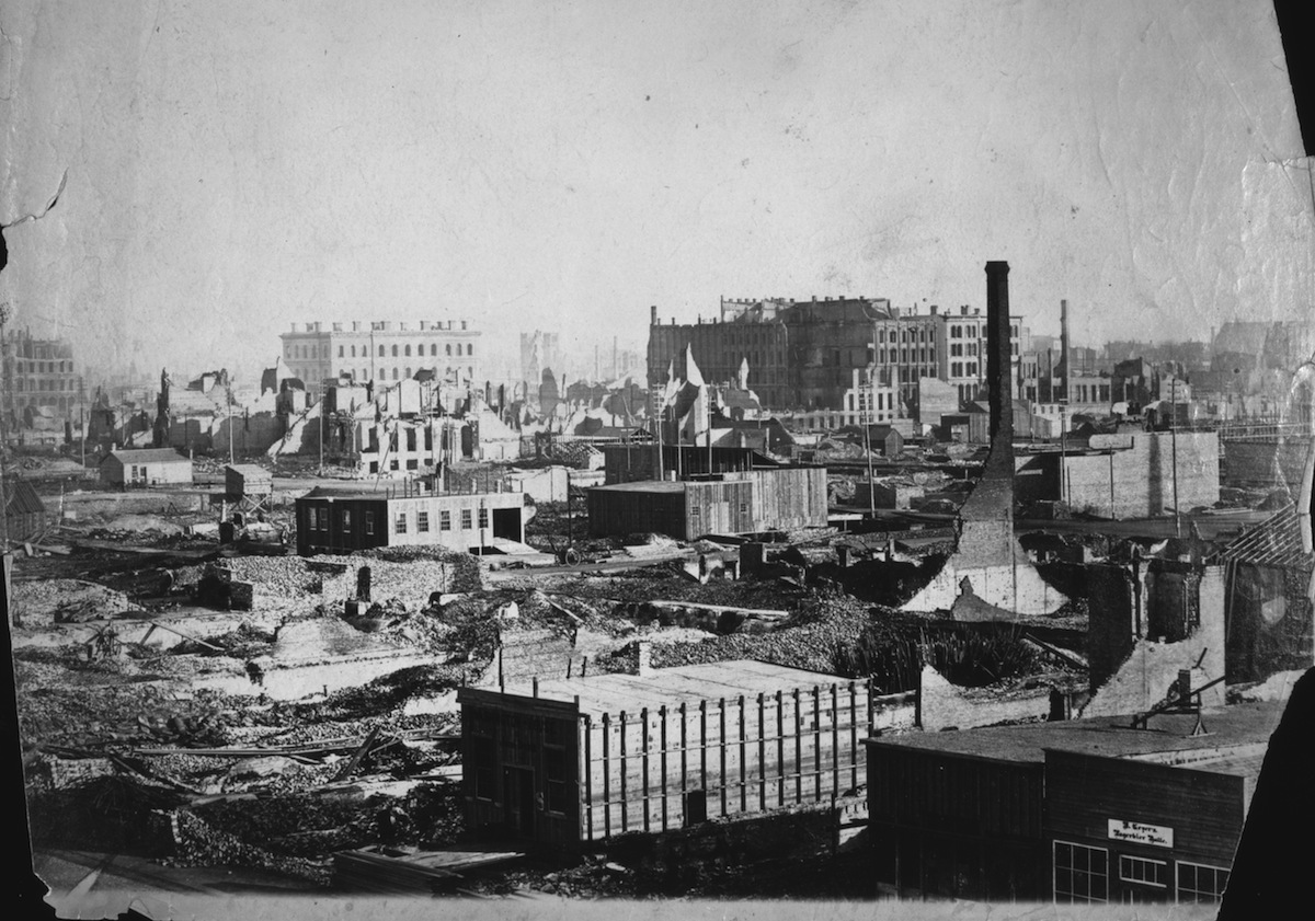 New buildings are already under construction just a few weeks after the catastrophic fire in Chicago, 1871. The view is from the corner of Randolph and Market streets.