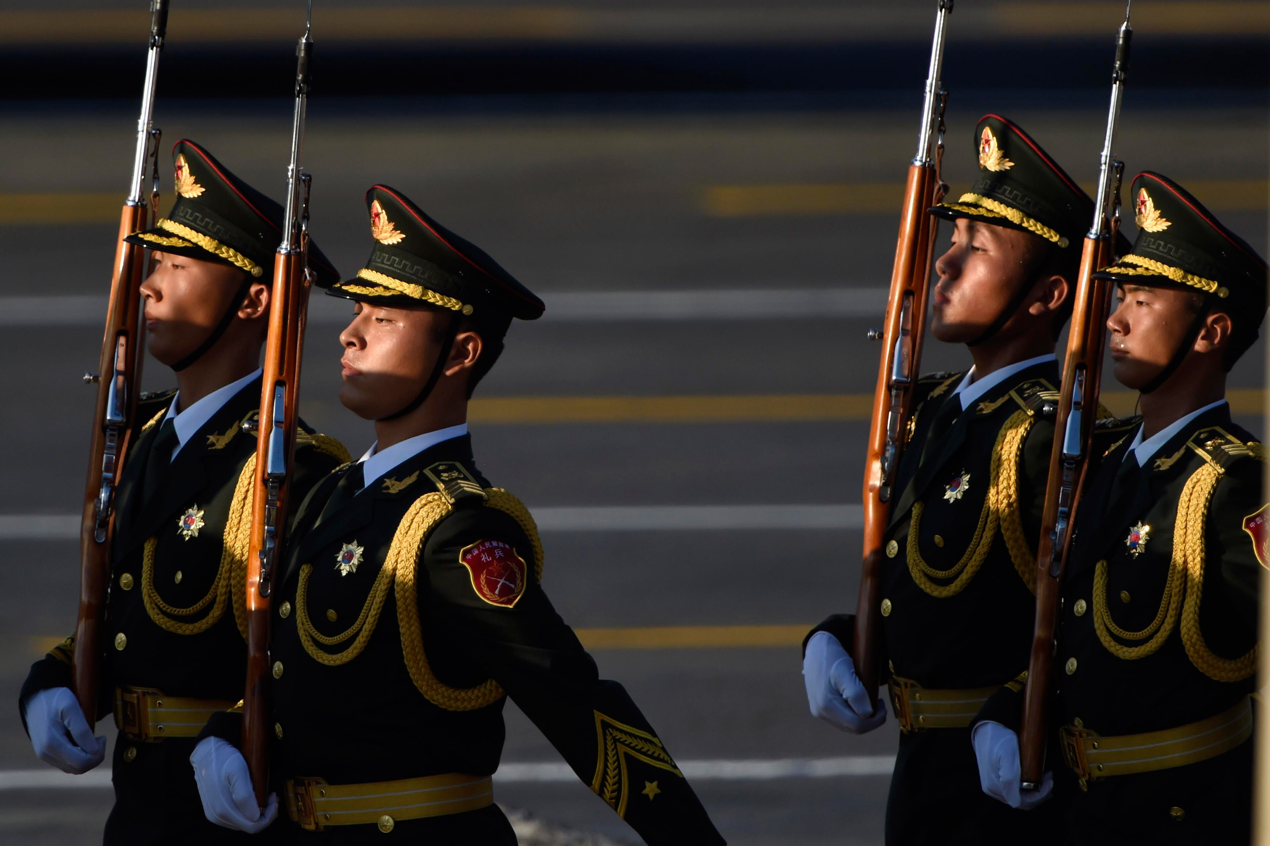 Guards of honor walk past Tiananmen Gate during the military parade celebrating the 70th anniversary of the end of World War II in Beijing, on Sept. 3, 2015.