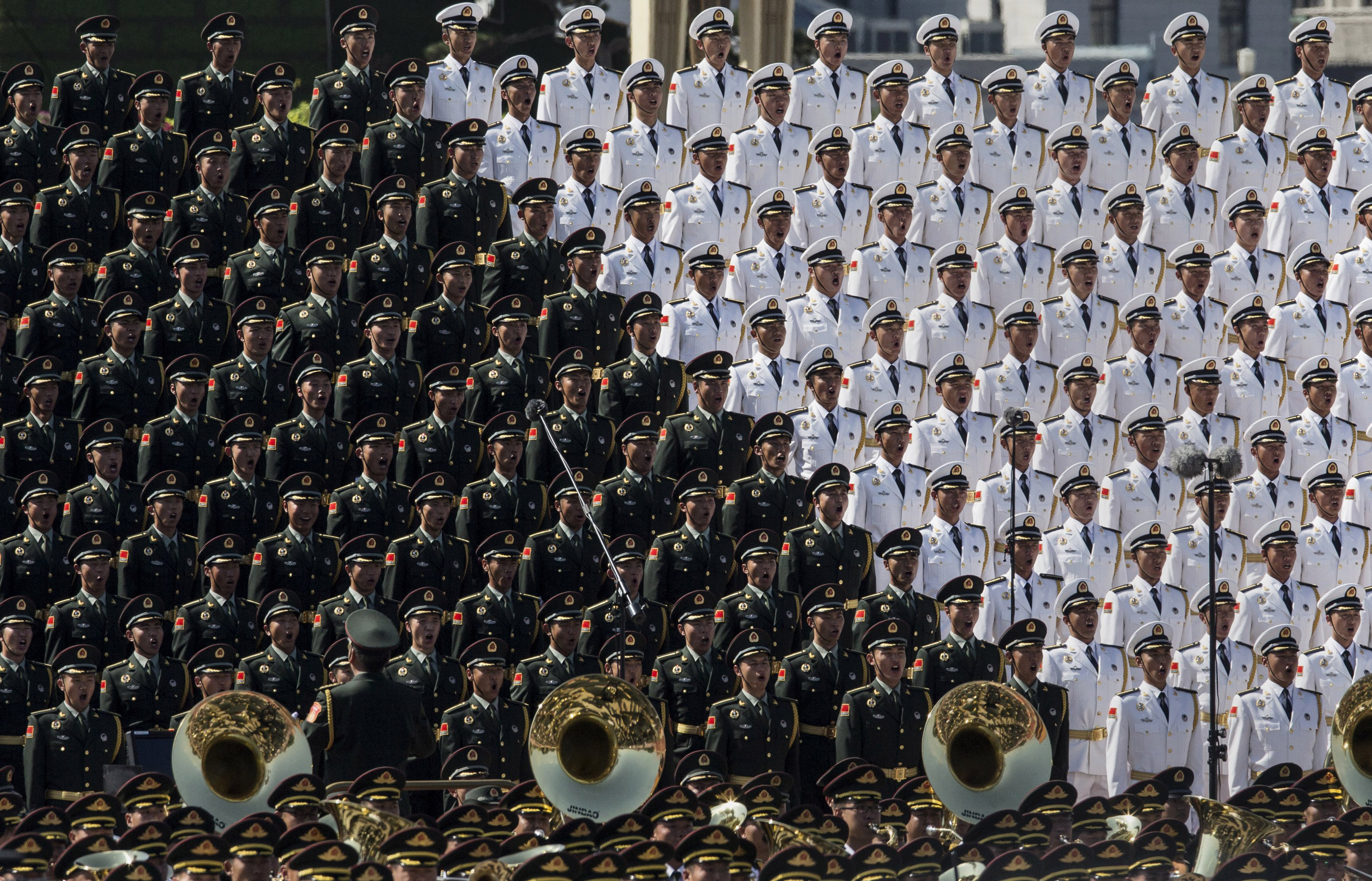Members of a Chinese military choir sing near  Tiananmen Square and the Forbidden City during a military parade in Beijing, on Sept. 3, 2015.