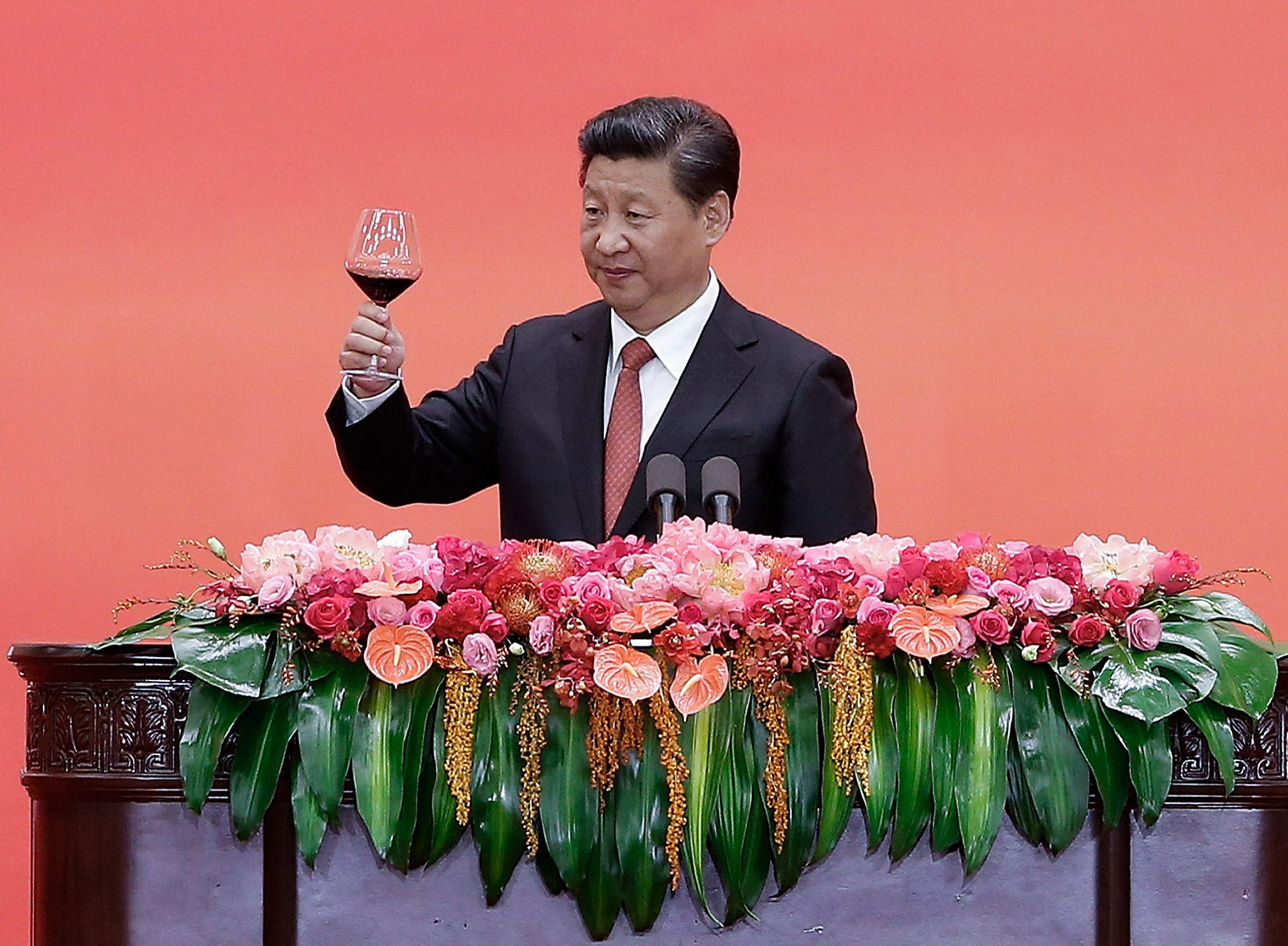 Chinese President Xi Jinping offers a toast after delivering a speech during a reception to mark the 70th anniversary of Japan's surrender during World War II in Beijing, on Sept. 3, 2015.
