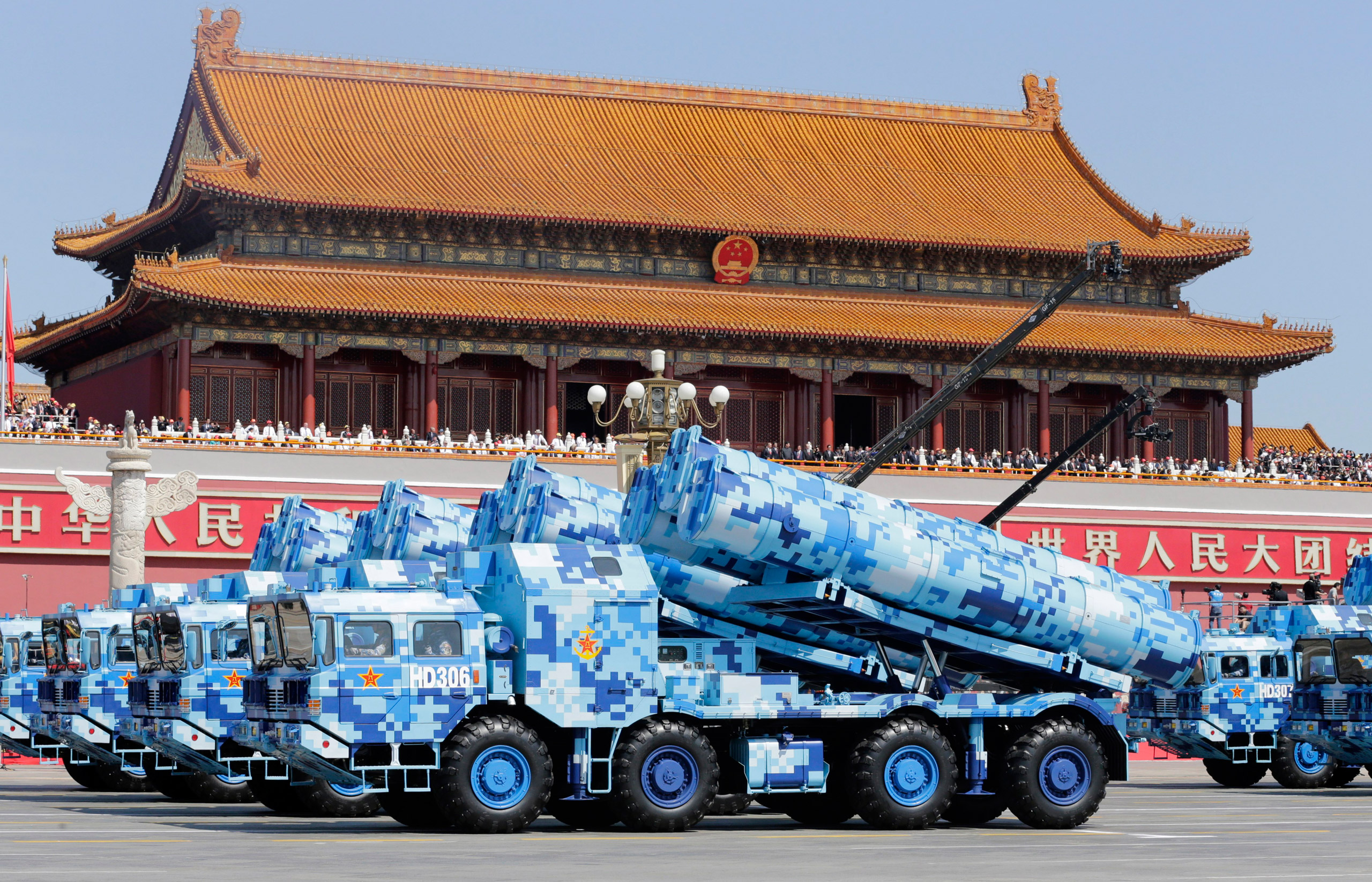 Military vehicles carrying shore-to-ship missiles drive past the Tiananmen Gate during a military parade to mark the 70th anniversary of the end of World War II in Beijing, on Sept. 3, 2015.