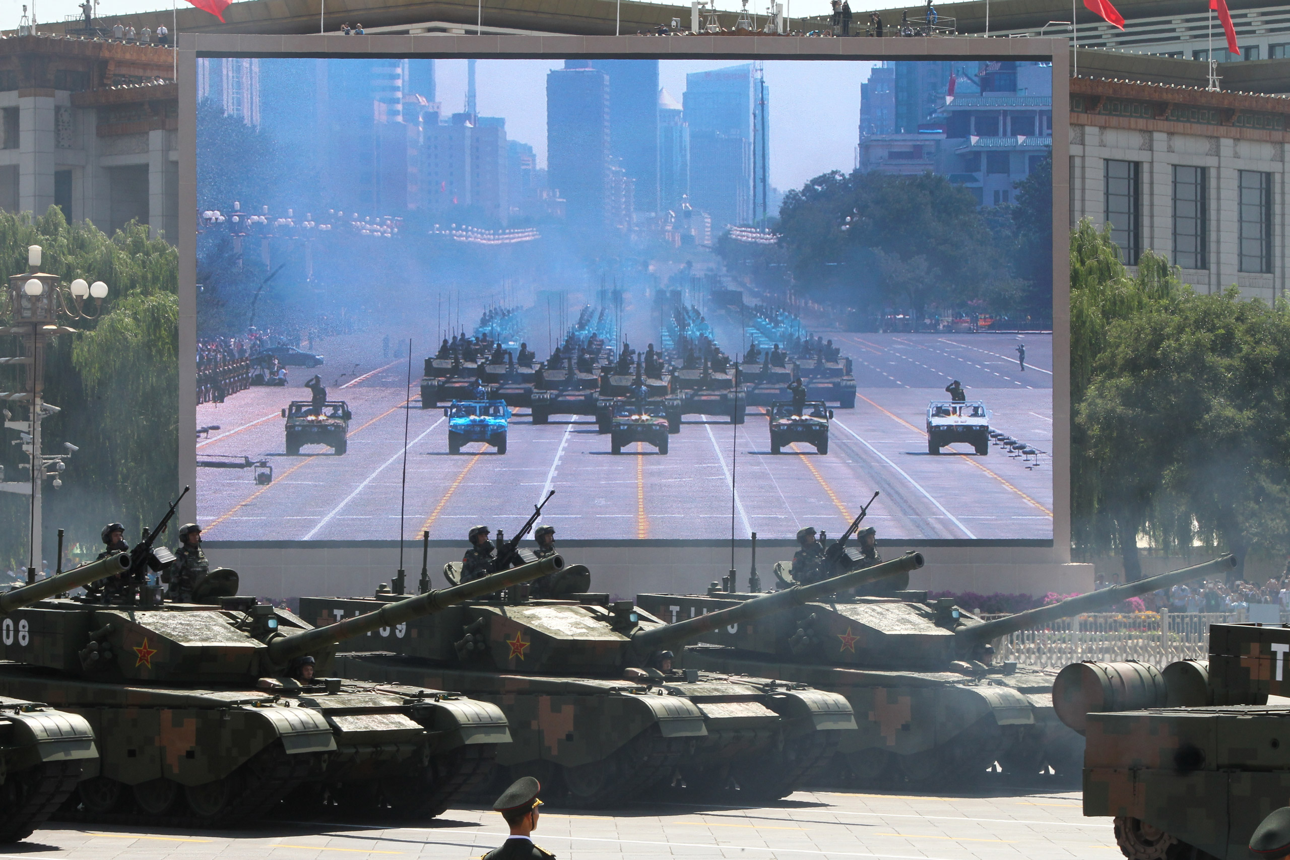 Military vehicles drive past Tiananmen Gate during the military parade marking the 70th anniversary of the end of World War II in Beijing, on Sept. 3, 2015.