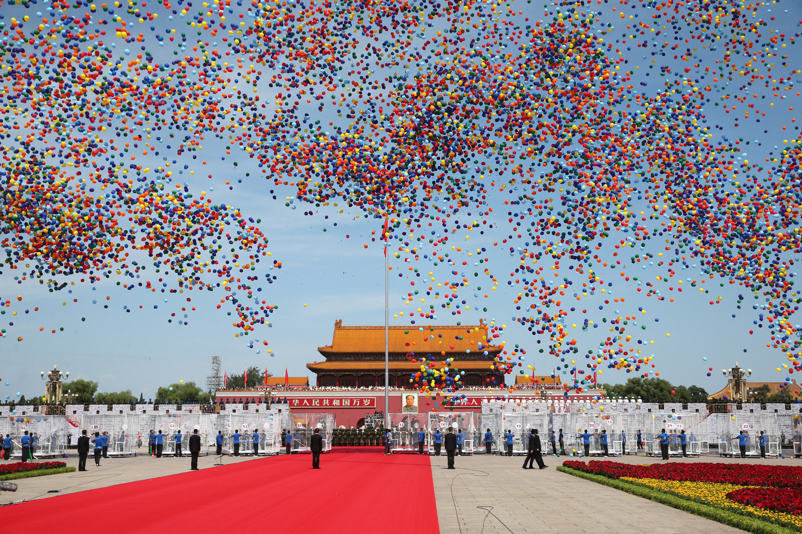 Balloons are released during the commemoration activities to mark the 70th anniversary of the end of World War II in Beijing, on Sept. 3, 2015.
