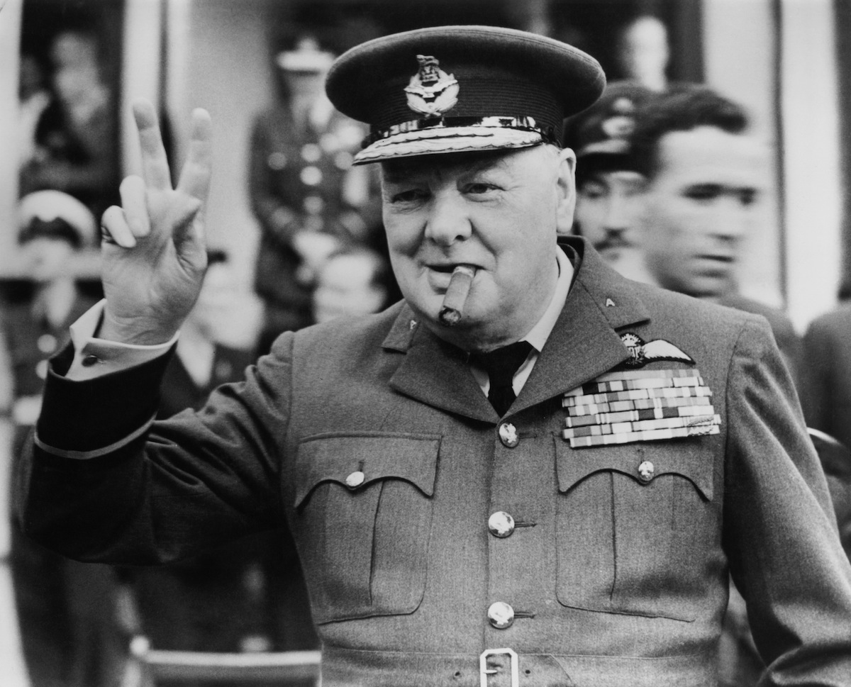 Winston Churchill (1874 - 1965) gives his famous v-sign at Croydon, 1948.