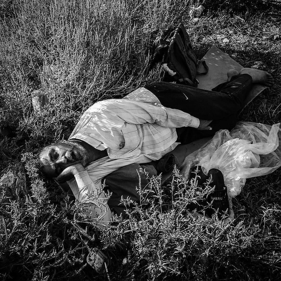 A man sleeps near the tracks at Tovarnik train station in Croatia. Sept. 18, 2015.