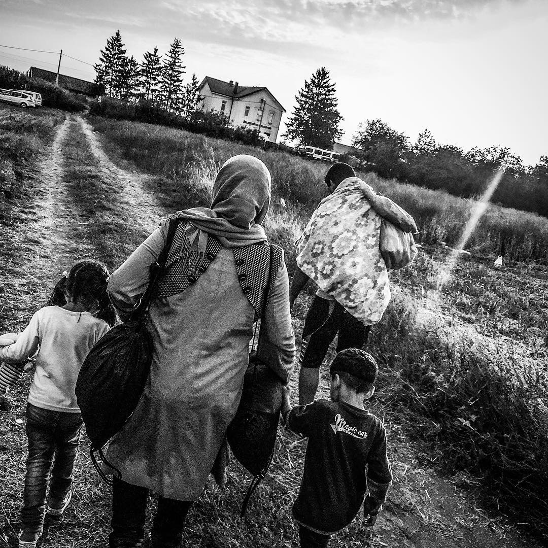 A Syrian refugee family arrives into Croatia from Serbia, hoping to board the train in Tovarnik. Sept. 20, 2015.