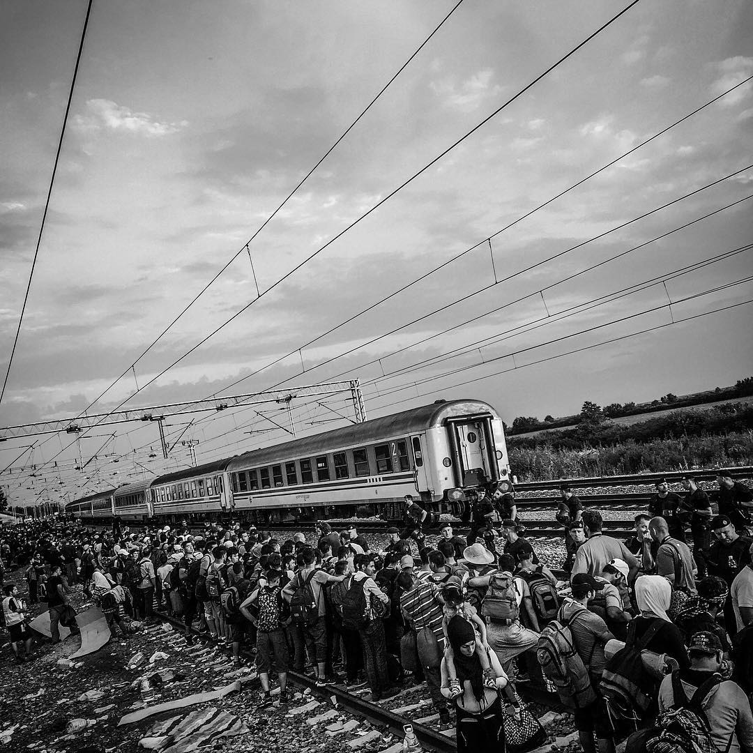 Hundreds of refugees wait to board the train in Tovarnik, Croatia. Sept. 20, 2015.