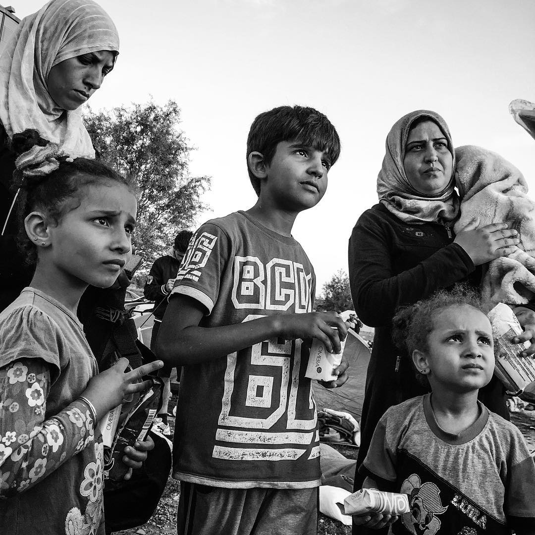 Families camped out overnight in Tovarnik, Croatia, receive aid from Austrian volunteers (soap and baby wipes). Sept. 19, 2015.