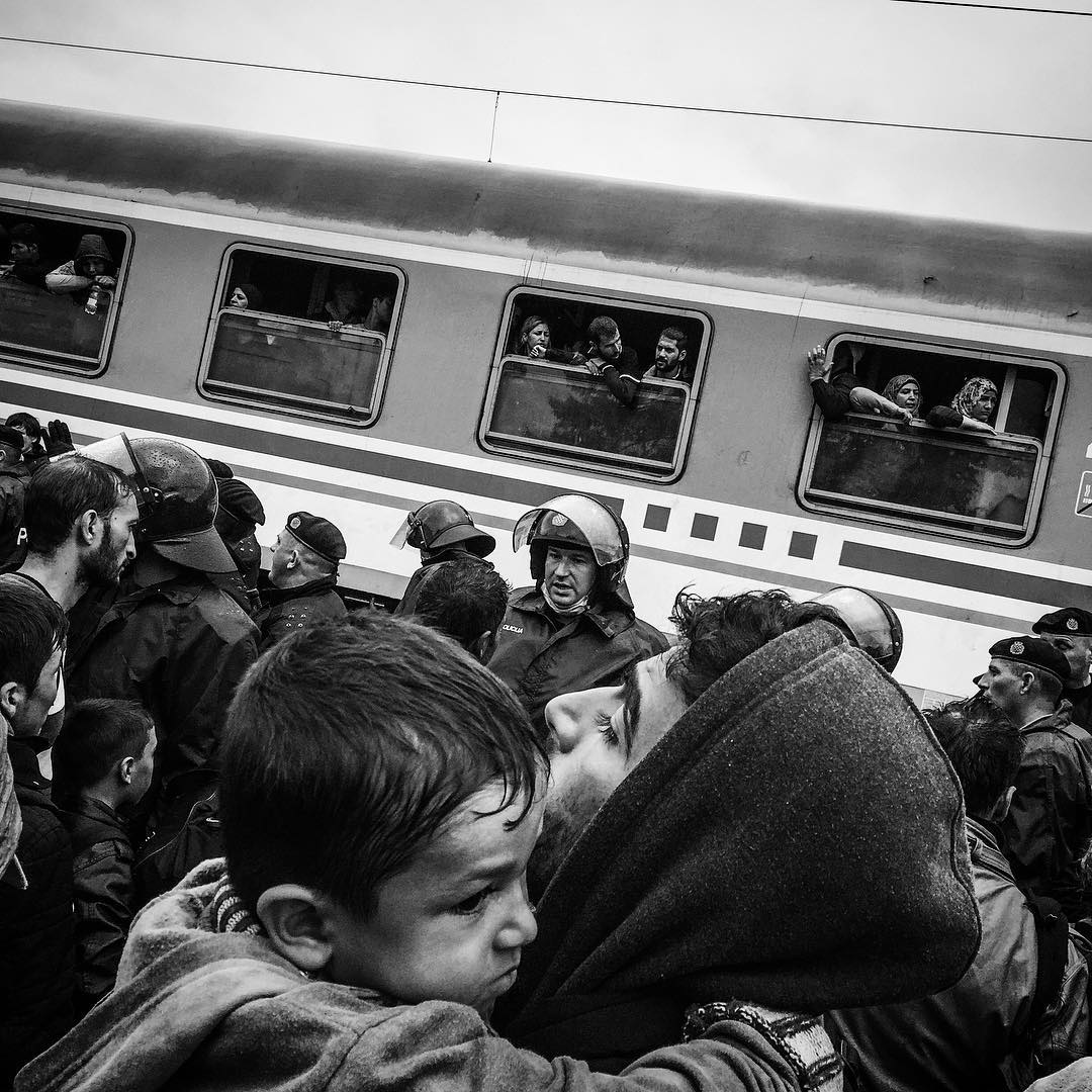 A family struggles to board the train in Tovarnik, Croatia. The train left without them. Sept. 20, 2015.