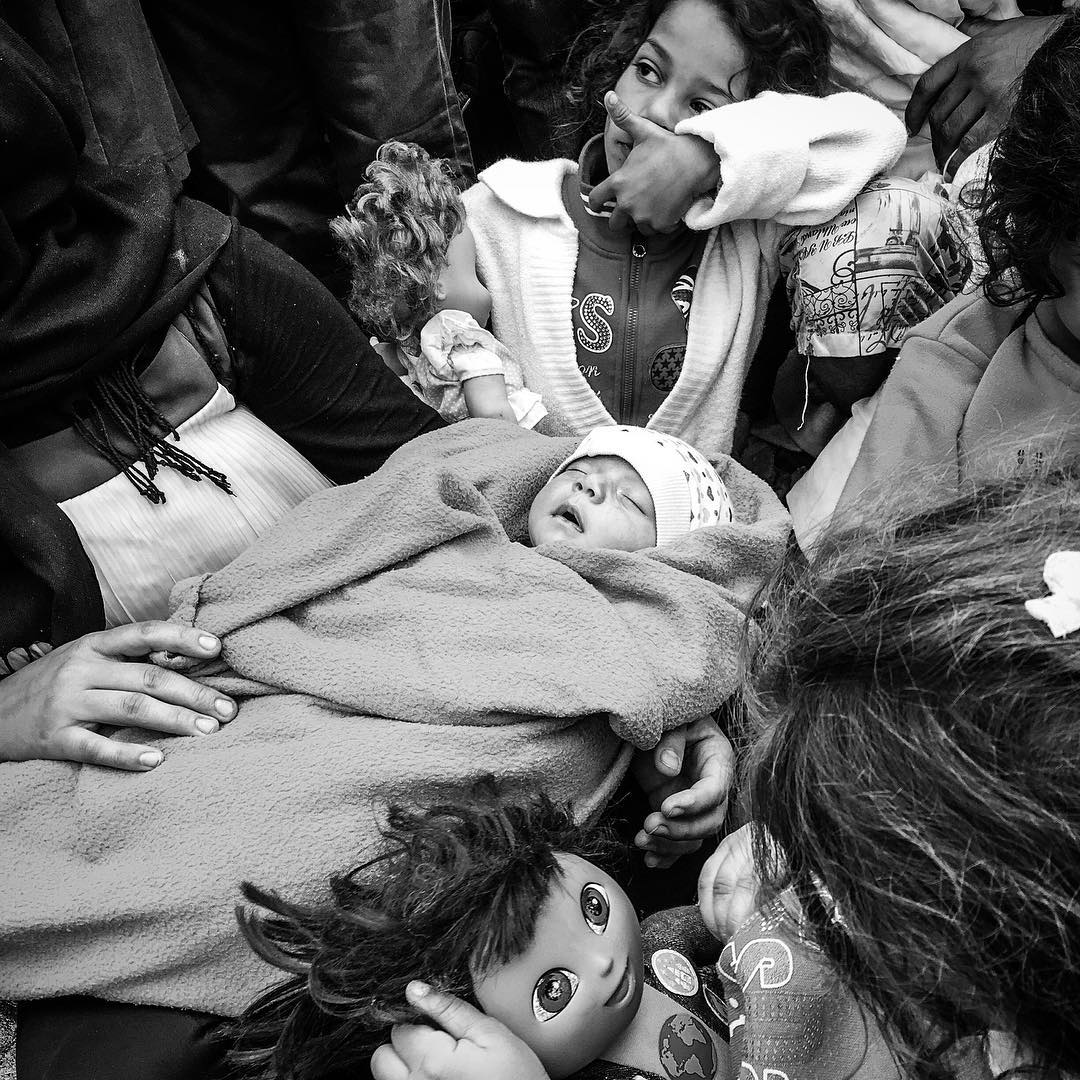 An Iraqi family waits for the train in Tovarnik, Croatia. The baby was born 40 days ago in Baghdad. Sept. 20, 2015.