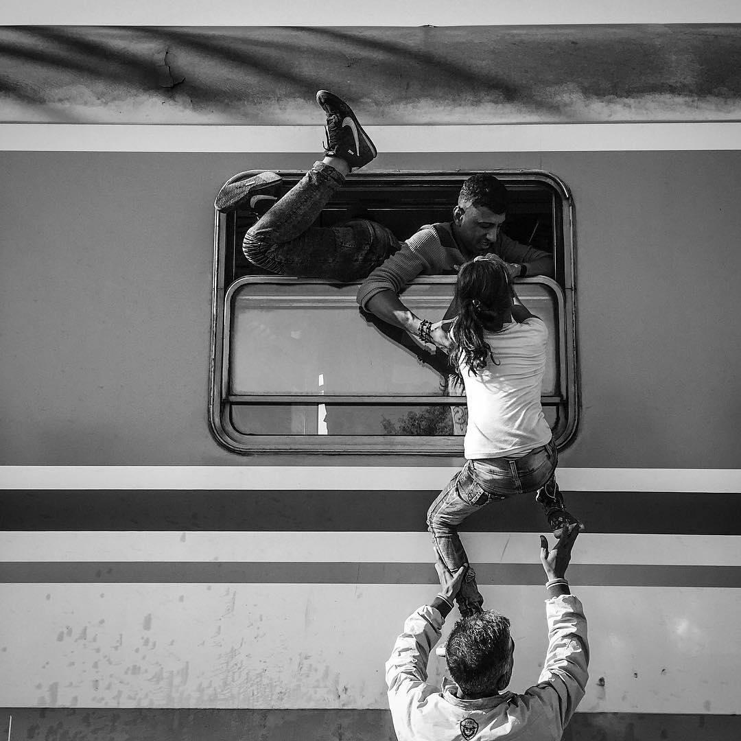 Hundreds of refugees pour onto trains in Tovarnik, Croatia. Sept. 18, 2015.