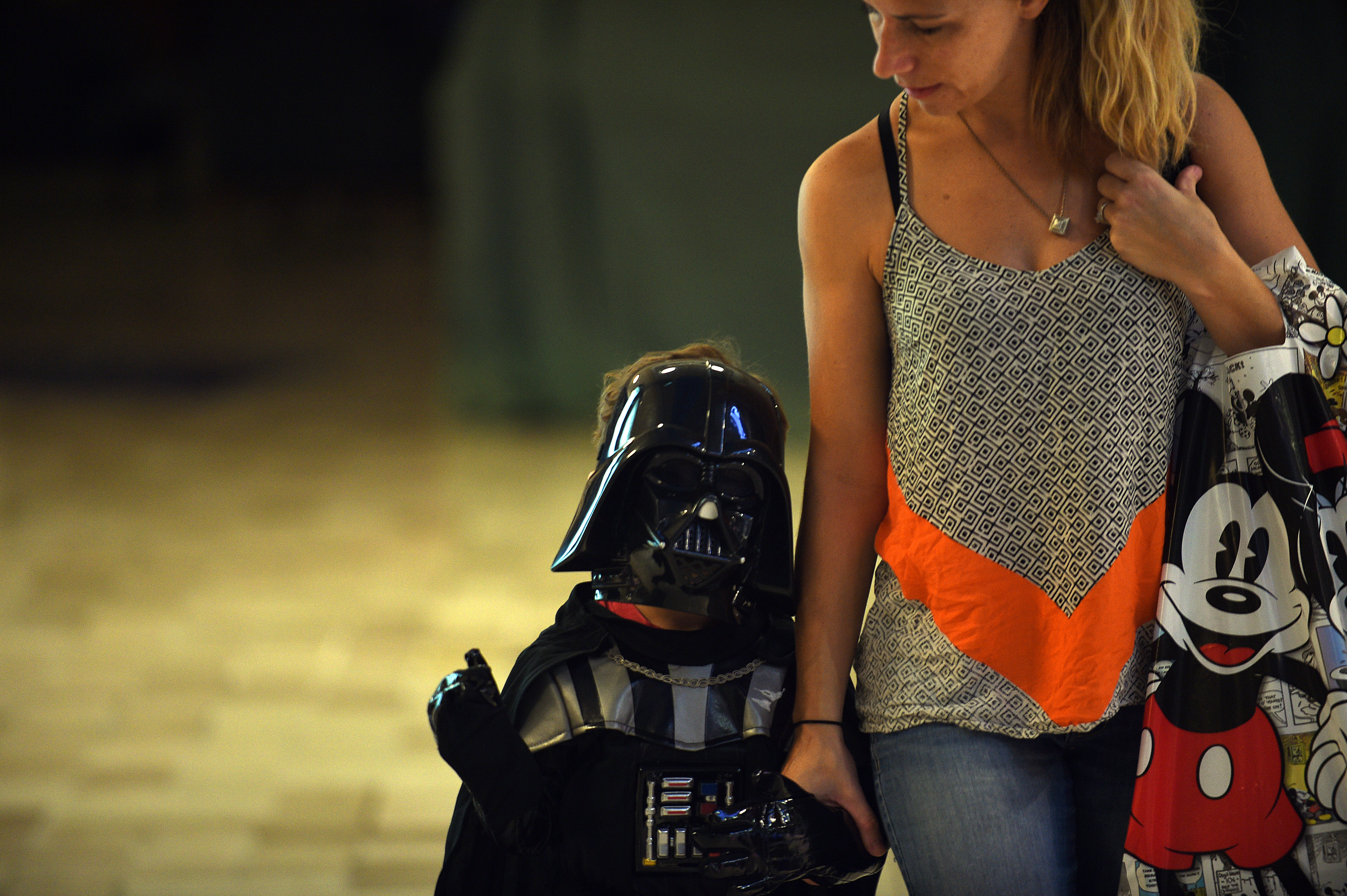 Star Wars enthusiast Jason Hume, 3, accompanied by his mother Holli Hume, leaves in full Star Wars outfit the Disney store at Tysons Corner Center Mall in McLean, Va., on Sept. 4, 2015, where he participated in  Force Friday,  a kickoff celebration for all the new Star Wars toys.