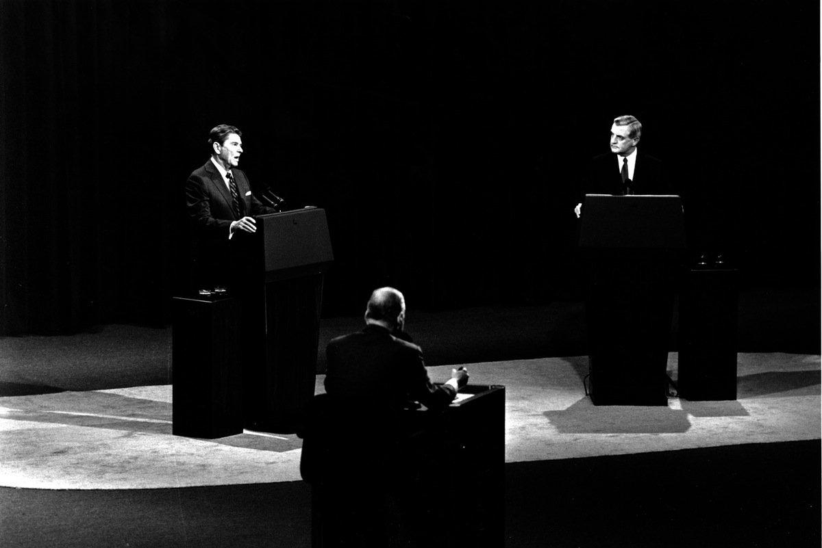 U.S. President Ronald Reagan, left, answers a question as Democratic candidate Walter Mondale listens during the second round of the 1984 Presidential debates in Kansas City, Mo. on Oct. 21, 1984.