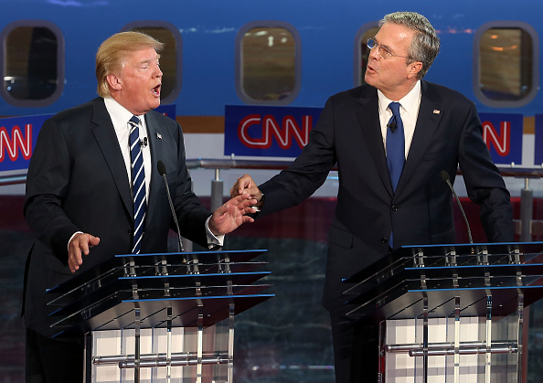 Republican presidential candidates Donald Trump and Jeb Bush argue during the presidential debates at the Reagan Library on September 16, 2015 in Simi Valley, California.