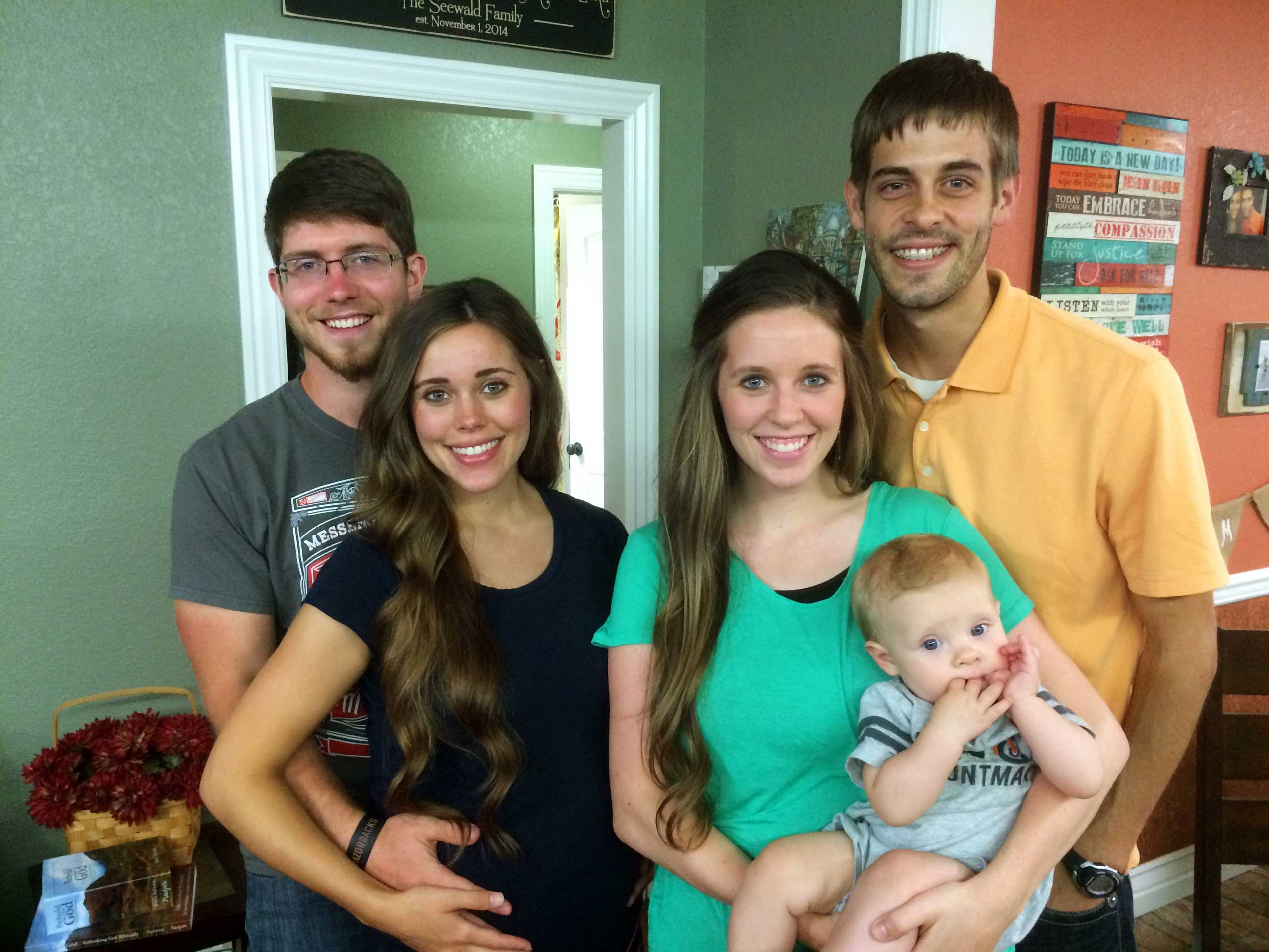 This image released by TLC shows, from left, Ben Seewald, Jessa Seewald, Jill Dillard, holding her baby Israel Dillard and Derik Dillard.