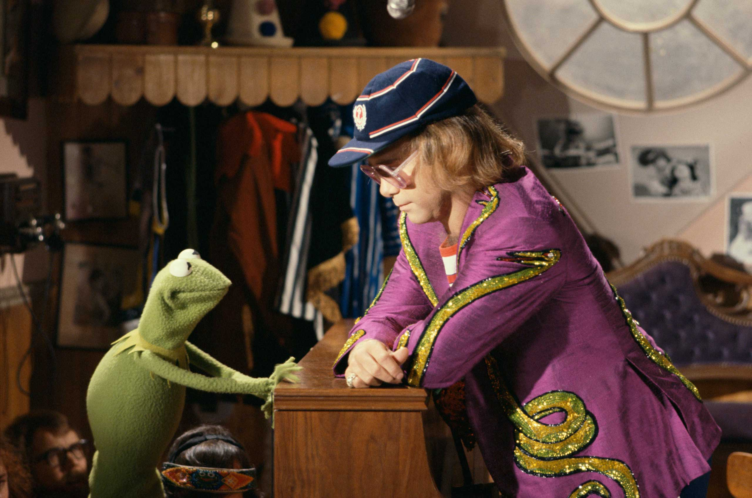 <b>Elton John</b> Photographed for TV Times in 1977.                                   Having already achieved superstardom on both sides of the Atlantic, Elton reaches the pinnacle of his career, appearing on <i>The Muppet Show</i> in Oct. 1977. But Kermit still has to persuade the reluctant rocker to perform his hit 'Benny and the Jets'.