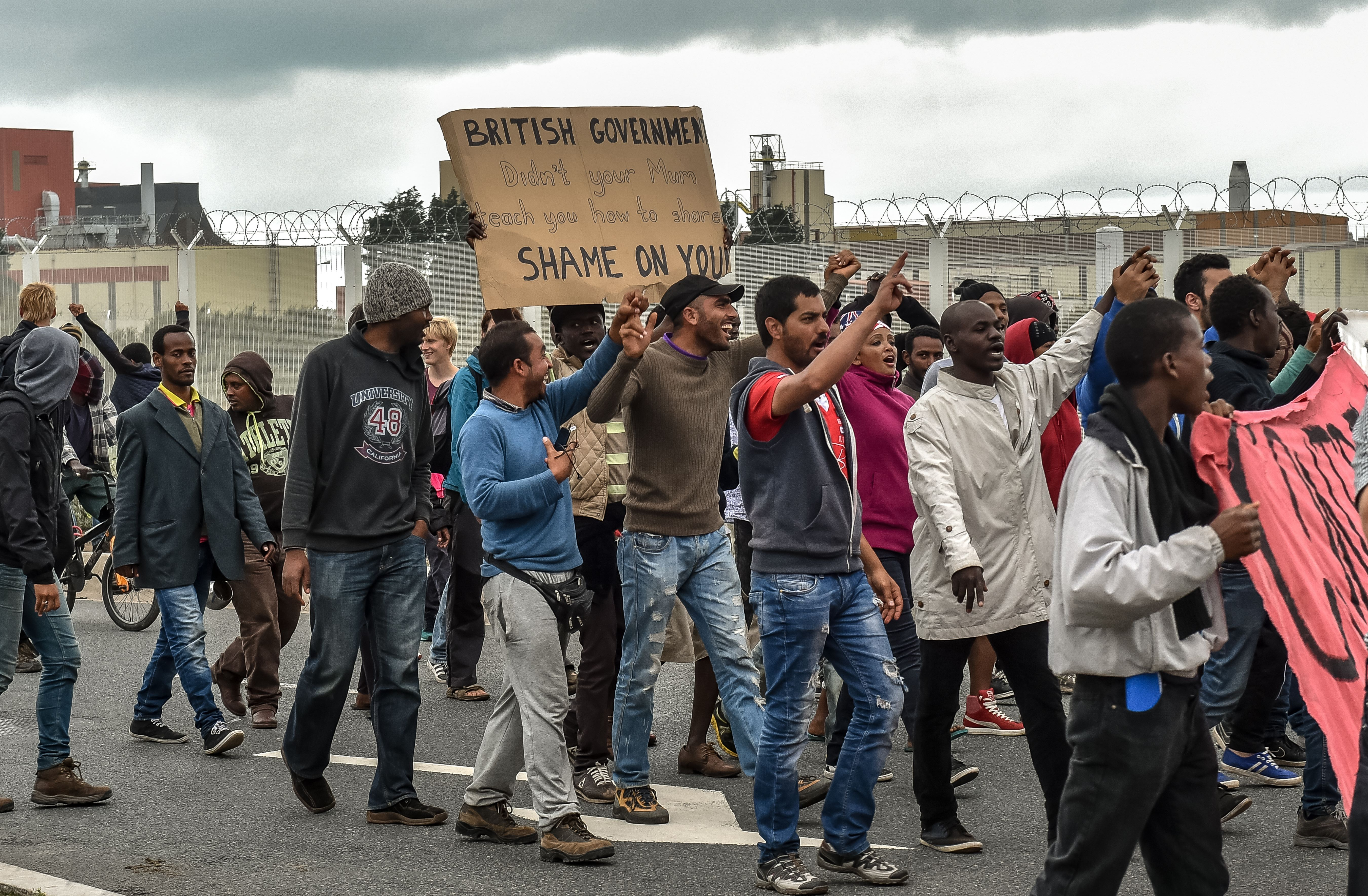 Illegal migrants demonstrate against British government, on Aug. 20, 2015 in Calais,