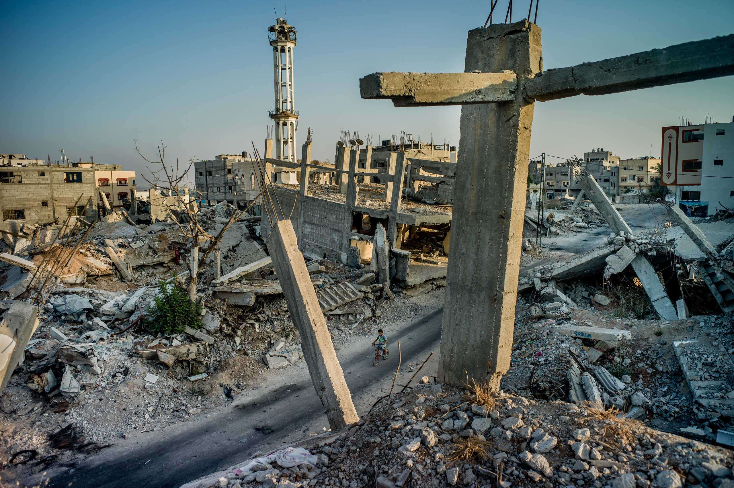 The New York Times: Walking in War's PathShejaiya, the destroyed neighborhood abutting the border fence with Israel, in Gaza City, Gaza Strip, on Aug. 1, 2015.