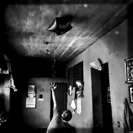 Tixtla de Guerrero, Mexico, March 24th, 2015:u2028Angel tries to grab the star balloon his aunt had just brought home from work. It was another weekday at home for him since teachers at his school had been attending marched in the region. Angel's dad is one of the missing 43 students. Photo © Adriana Zehbrauskas @adrianazehbrauskas /Shot #onassignment for #buzzfeednews with @karlazabs in #mexico #guerrero #ayotzinapa #tixtla #documentary #longtermproject #photojournalism #iphonehttps://instagram.com/p/0p3pFGN5Nj/?taken-by=adrianazehbrauskas