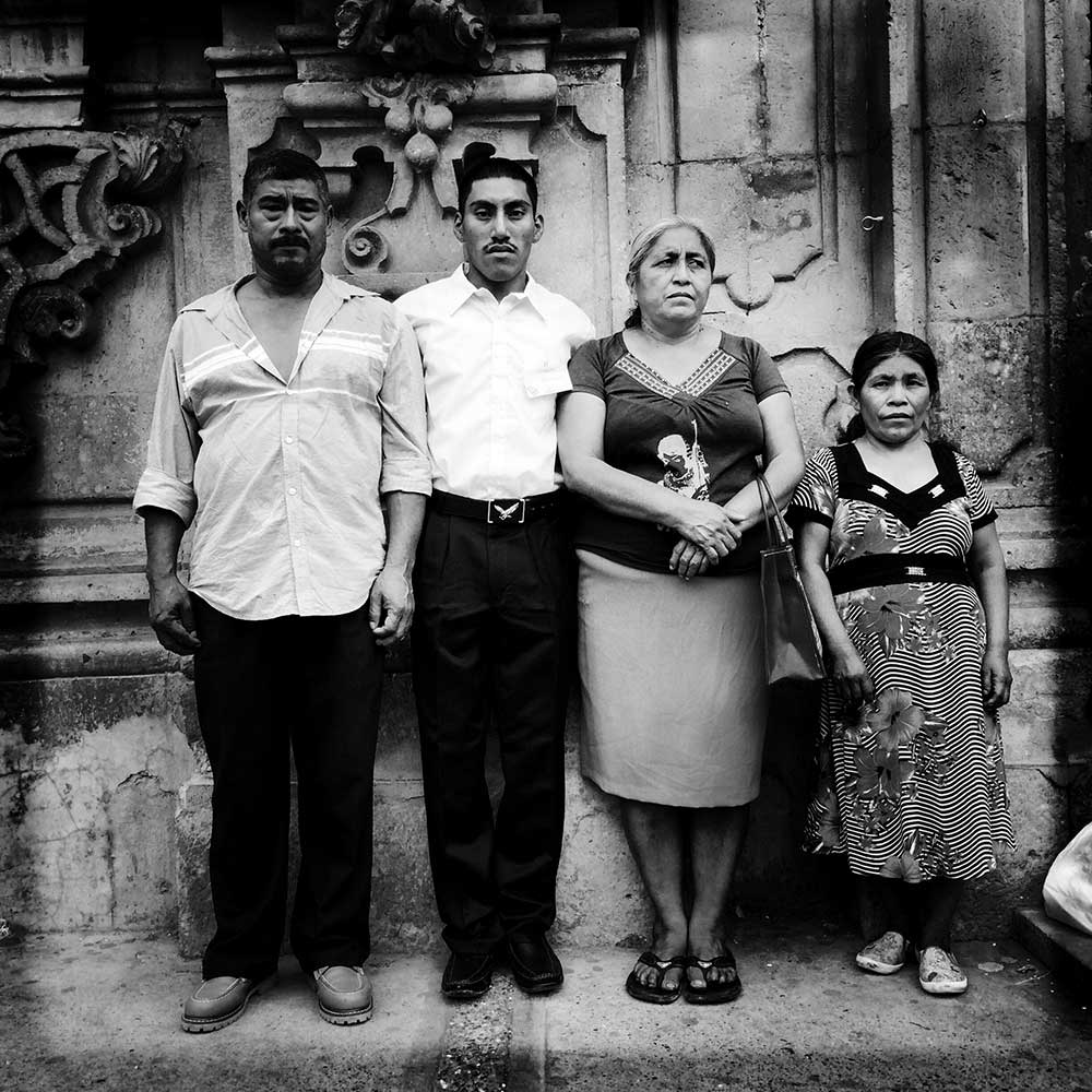 Family Portrait After Church. Don Bernabe (left) and Dona Delfina (third from left), parents of missing student Adan Abrajan de la Cruz, pose for a family portrait with his godson, Marcos, and his mother, Doña Rosa, after his first communion. Tixtla, Guerrero, Mexico., May 24, 2015