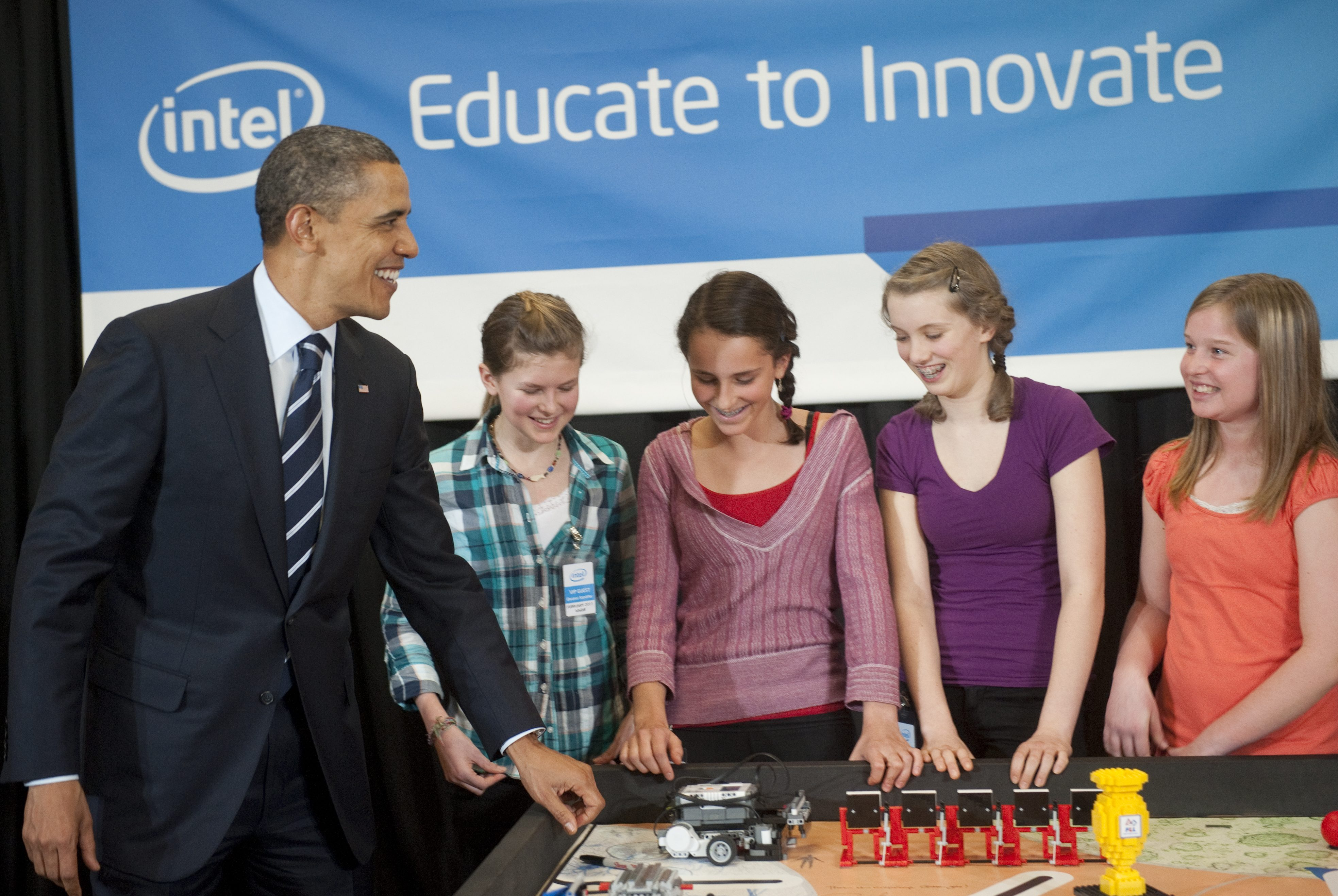 US President Barack Obama speaks with Intel Science Talent Search finalists, 7th graders from the BindleBot Intel First LEGO Robotics Team from Robert Gray Middle School, during a student demonstration at Intel in Hillsboro, Oregon, on February 18, 2011.        AFP PHOTO / Saul LOEB (Photo credit should read SAUL LOEB/AFP/Getty Images)