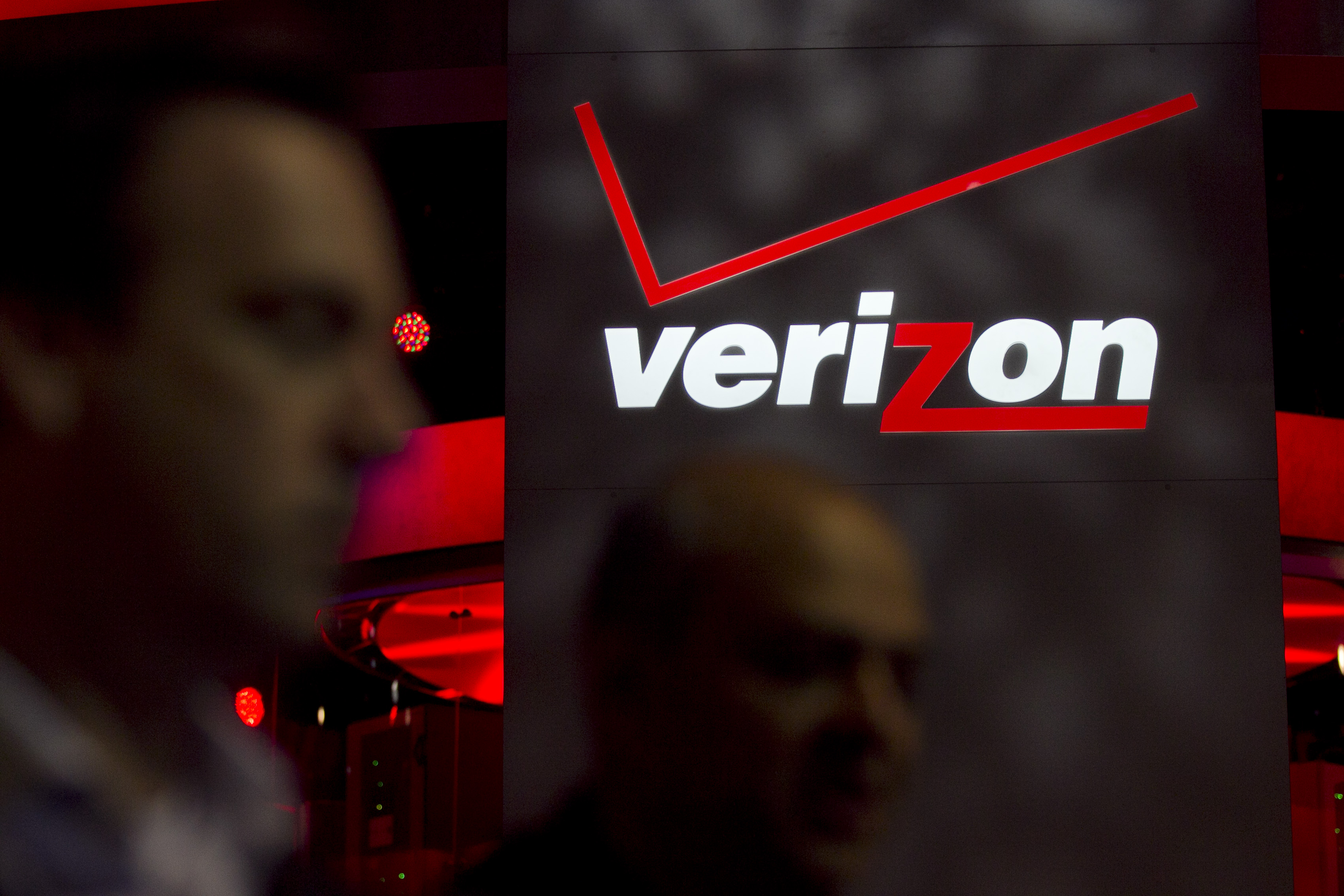 The Verizon Communications Inc. logo is seen at the International Consumer Electronics Show (CES) in Las Vegas, Nevada, U.S., on Thursday, Jan. 12, 2012.