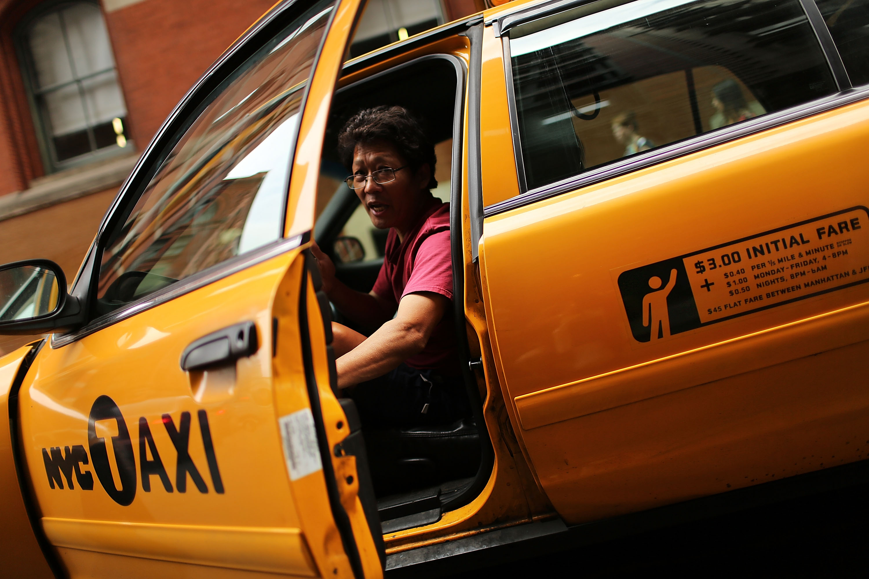 A taxi driver pauses in his vehicle on September 4, 2012 in New York City.