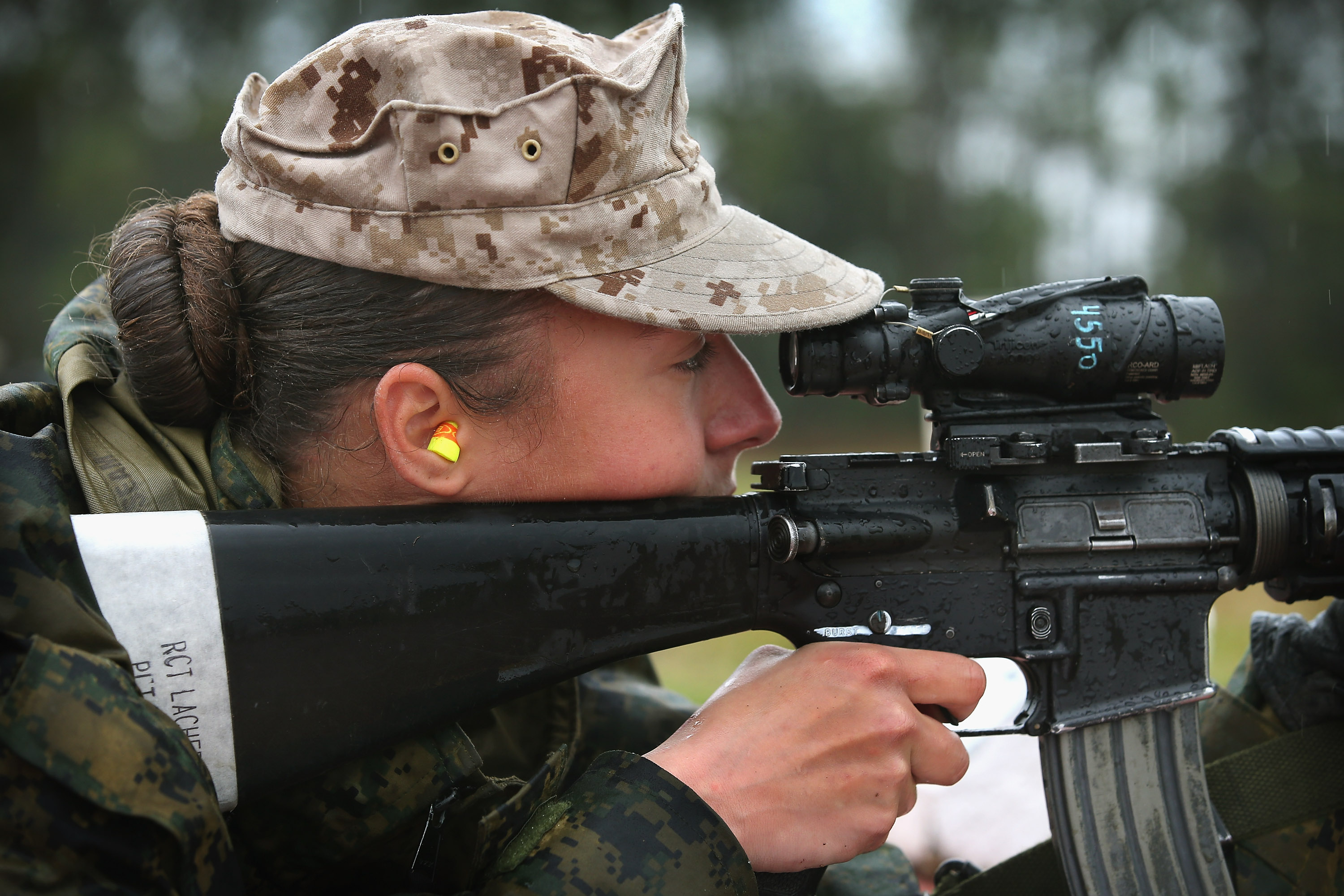 Marine recruit Cora Ann Lacher from Manuet, NY fires on the rifle range during boot camp on Feb. 25, 2013.
