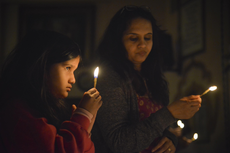 Simran Mattikalli, 7, and her mother Kavitha, of Potomac, MD, celebrate Diwali