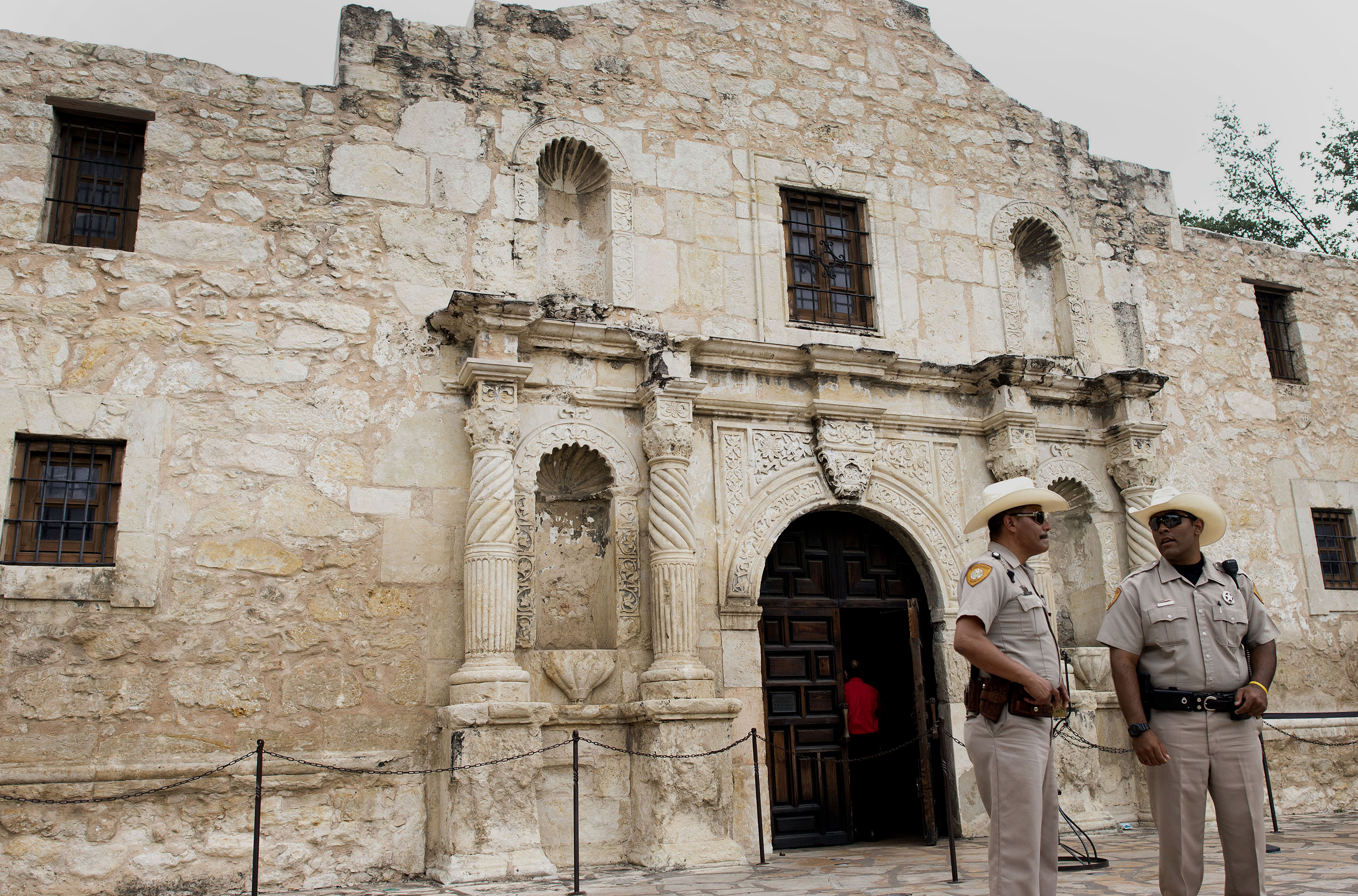 Security guards stand in front of the Alamo in downtown San Antonio, Texas, U.S., on Tuesday, June 3, 2014