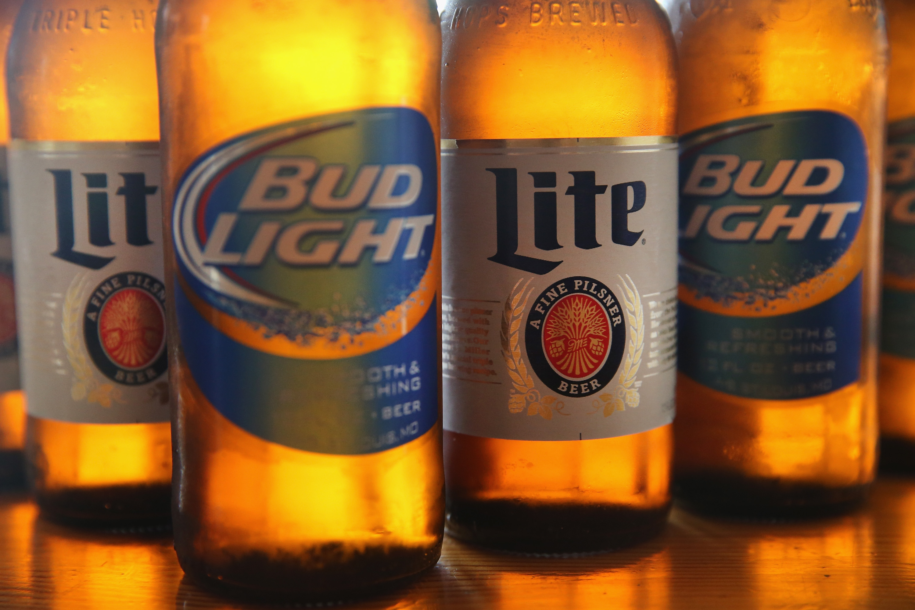 In this photo illustration, bottles of Miller Lite and Bud Light beer that are products of SABMiller and Anheuser-Busch InBev (respectively) are shown on September 15, 2014 in Chicago. Illinois.