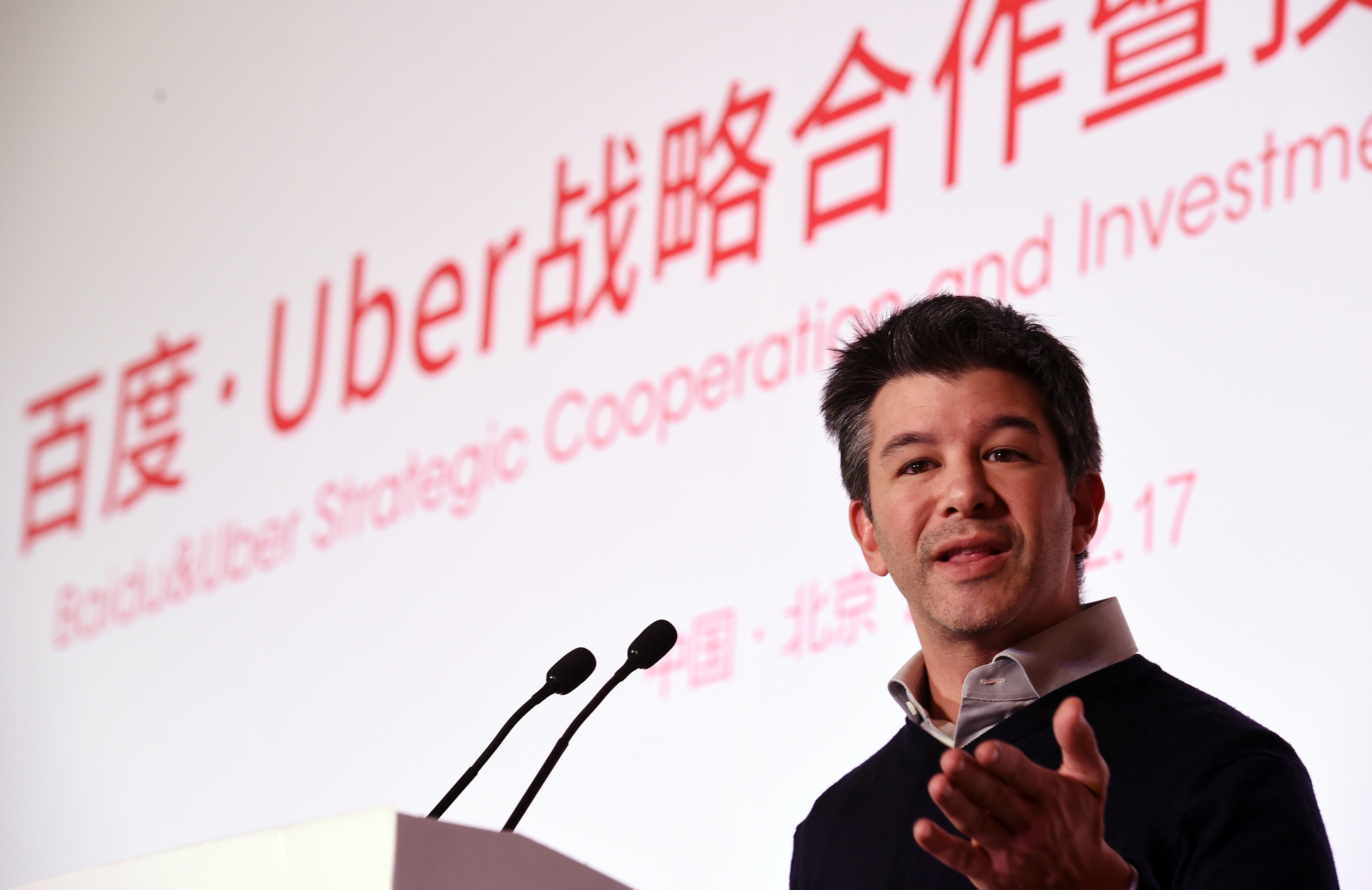 Uber CEO Travis Kalanick speaks at a ceremony at the Baidu headquarters in Beijing on December 17, 2014.