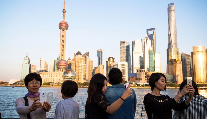 Tourists taking selfies in Shanghai, China.