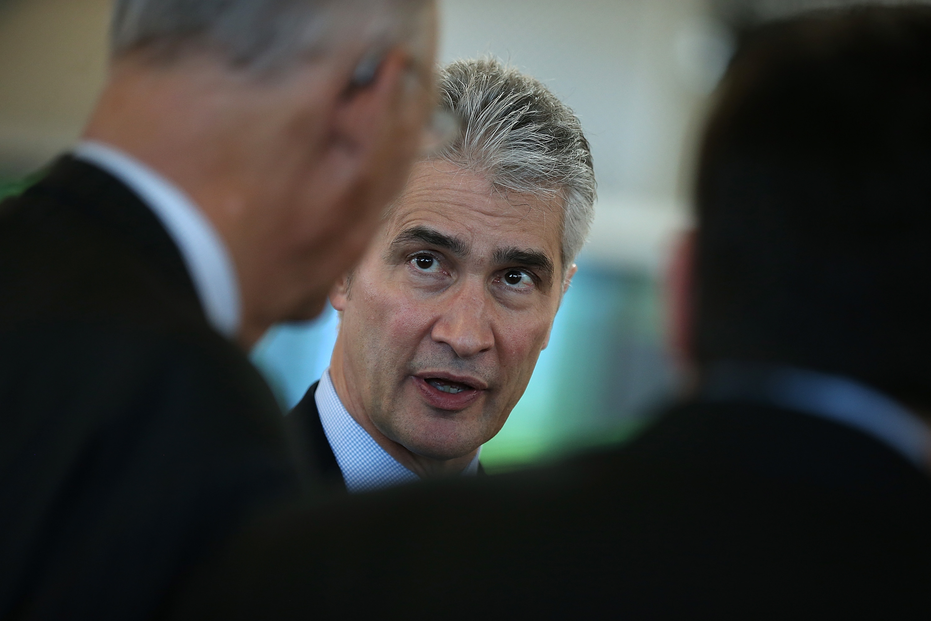 United Airlines Chairman, President and CEO Jeff Smisek talks with attendees before a news conference to announce the opening of a new United terminal at San Francisco International Airport on January 24, 2014 in San Francisco, California.