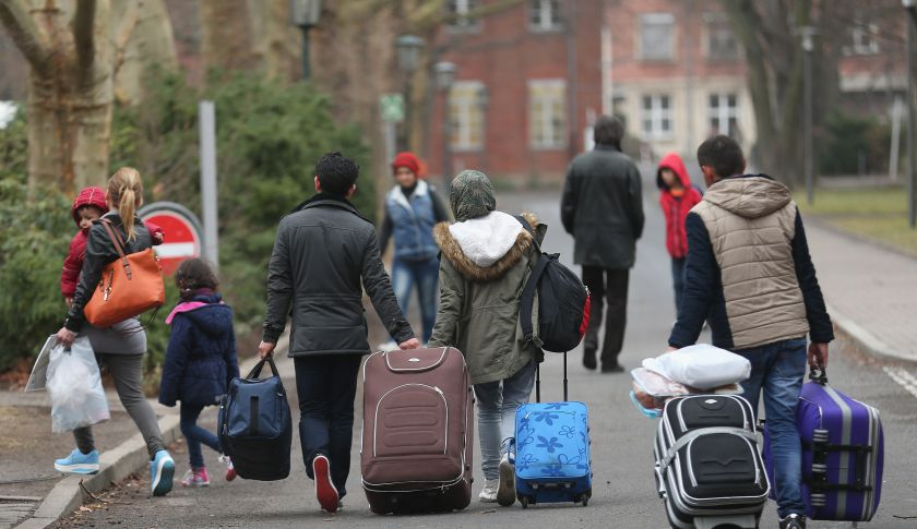 Refugees and migrants arrive at the Central Registration Office for Asylum Seekers in Berlin, Germany.