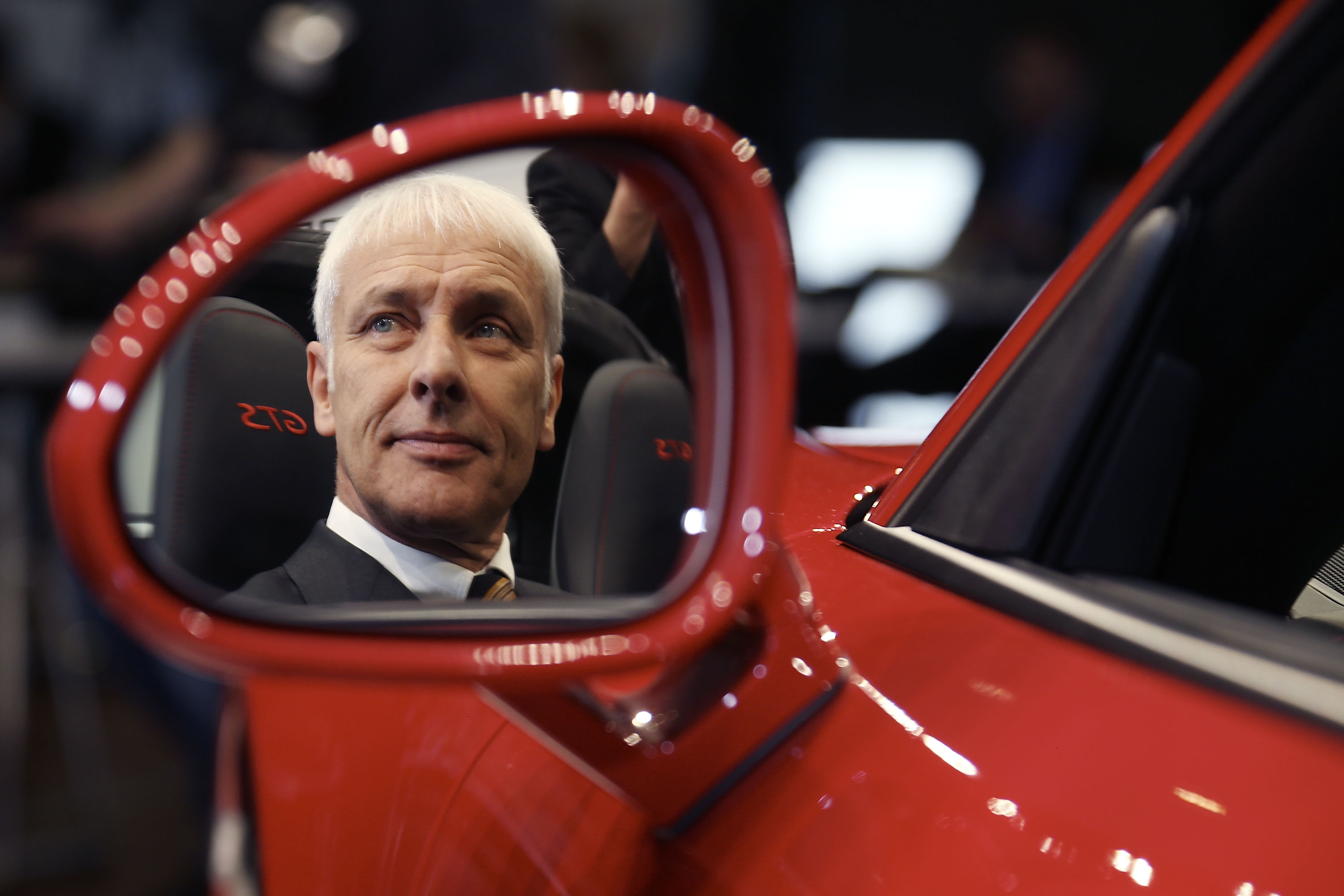 Matthias Mueller, CEO of Porsche AG poses in a Porsche Targa 4 GTS at the Porsche AG annual press conference in Stuttgart, Germany, on March 13, 2015.