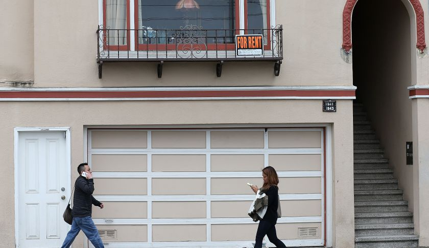 Pedestrians walk by an apartment for rent in San Francisco, Calif.