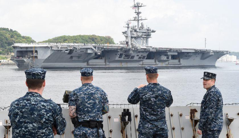 The nuclear-powered aircraft carrier USS George Washington .